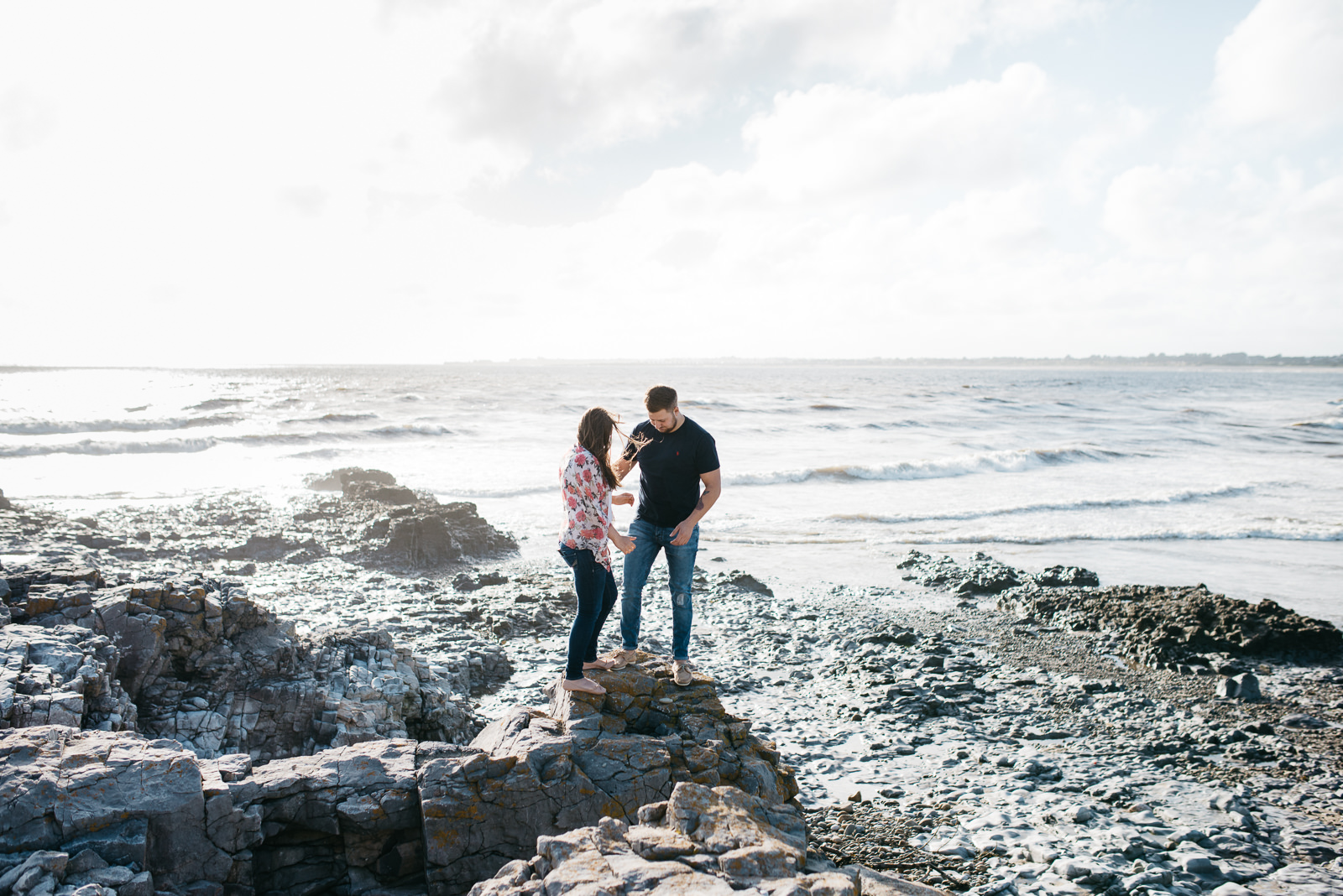 Helping his girlfriend onto a highpoint at Ogmore on their couple shoot