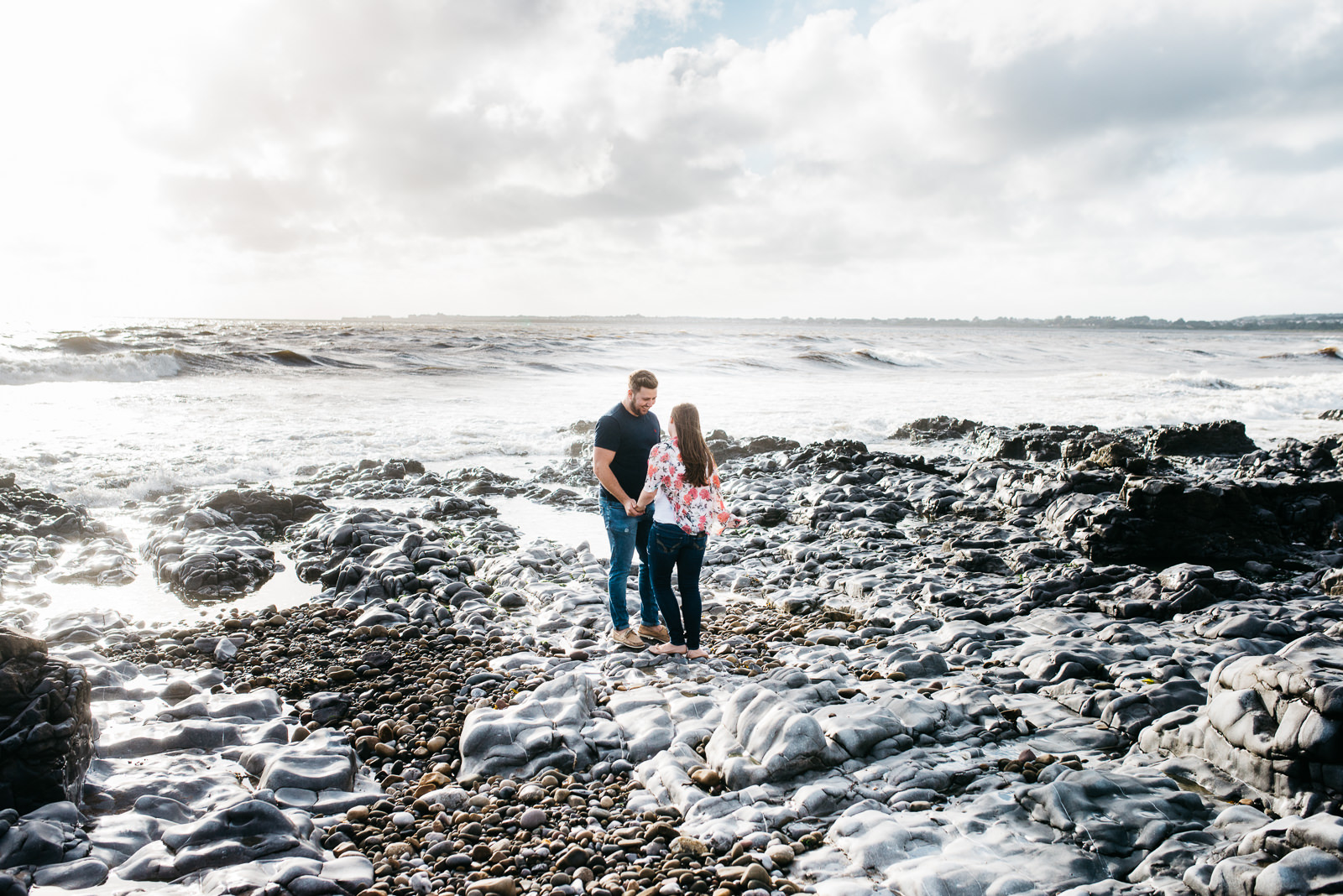 Couple chatting ahead of their Cardiff Wedding at Ogmore on Sea