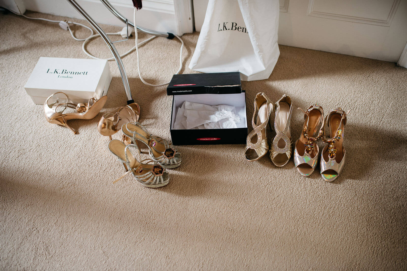 Charlotte Olympia Brides shoes and Stylish silver and glitzy Bridesmaid shoes during bridal preparations