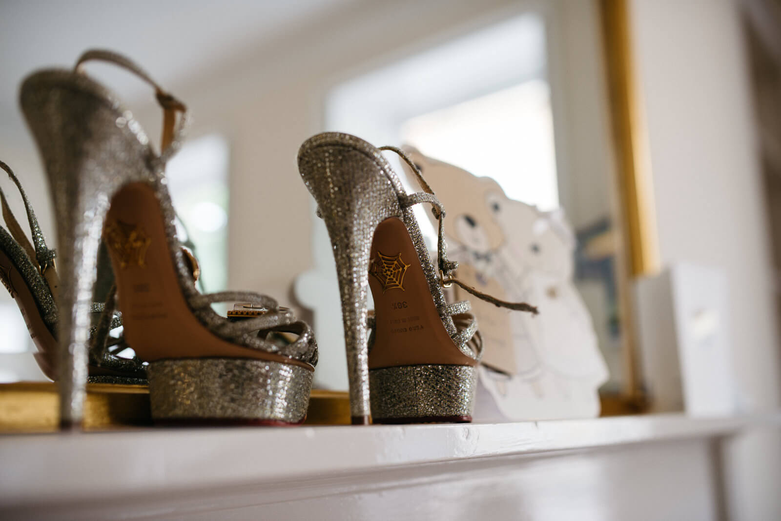 Charlotte Olympia wedding shoes on fireplace