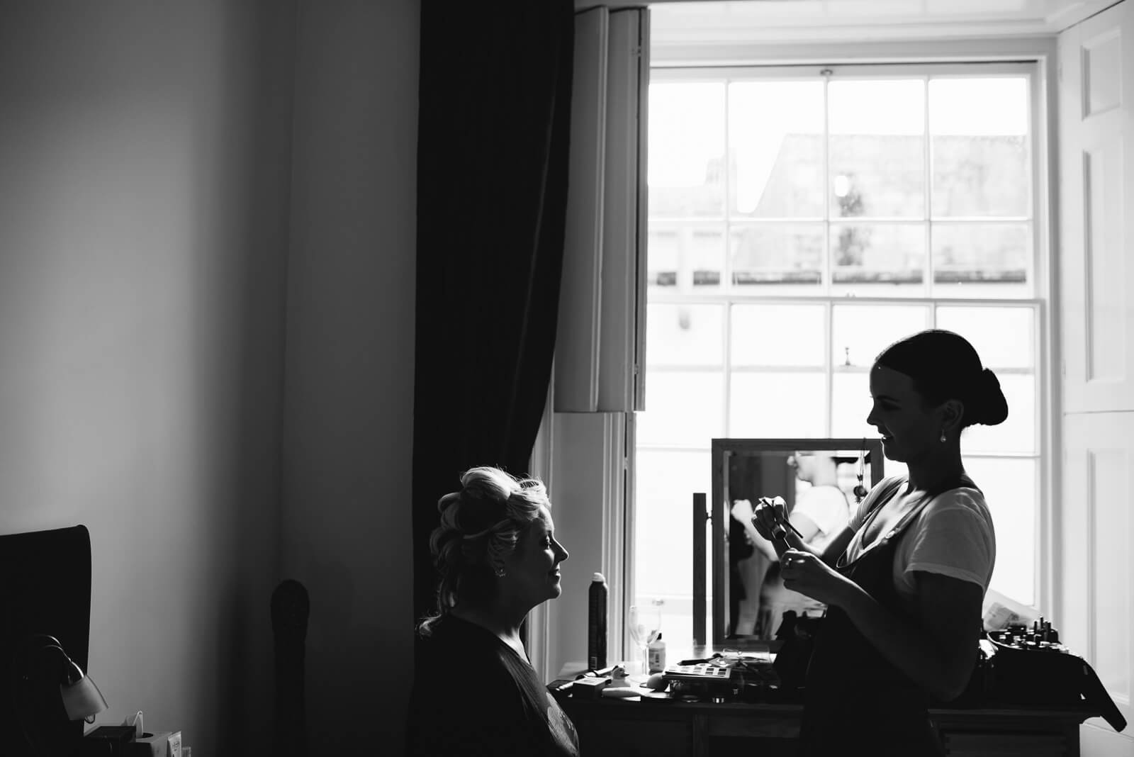 Black and white photograph of Bride during her prep before marrying at the Roman Baths