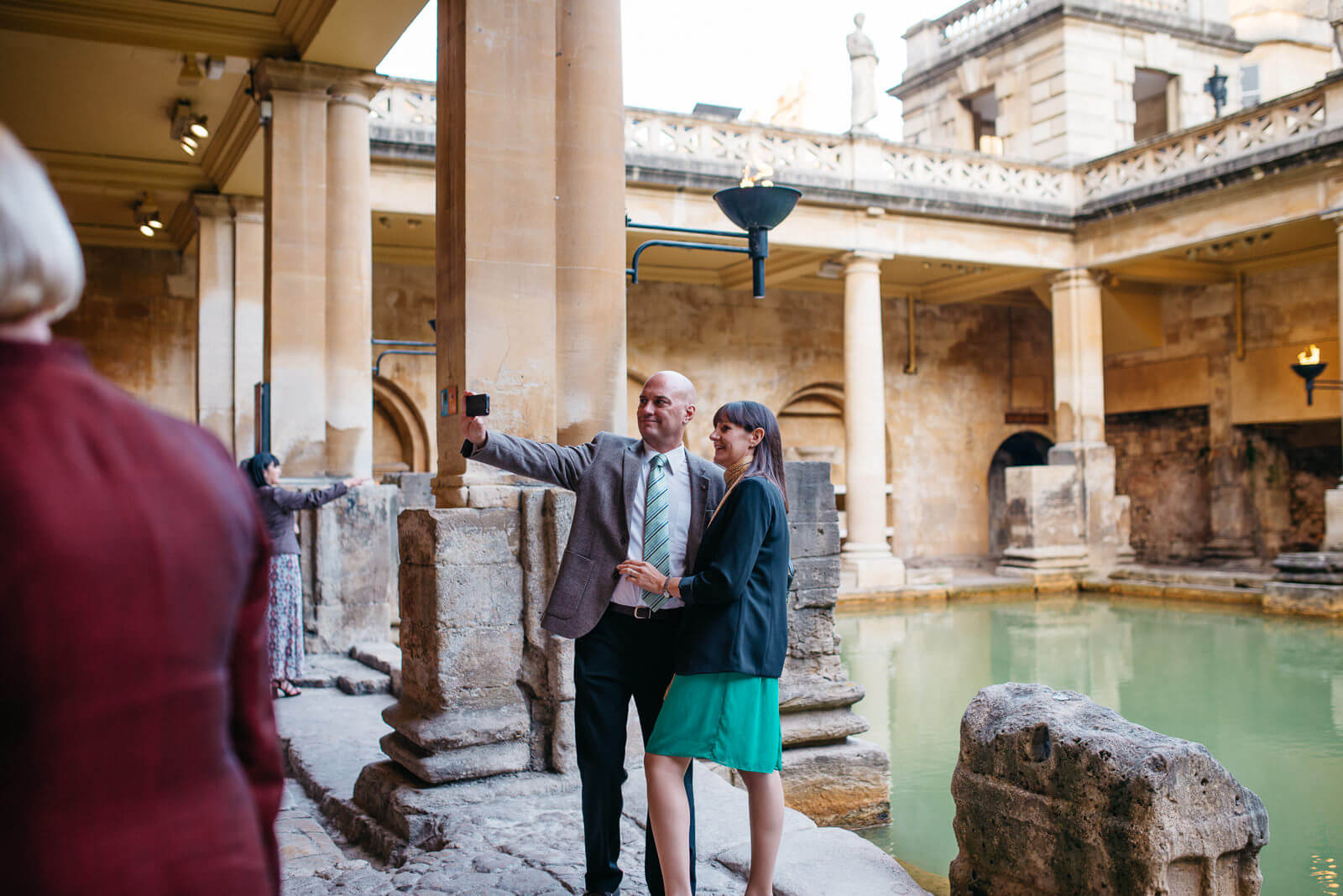 Guests taking selfies inside the Roman Baths