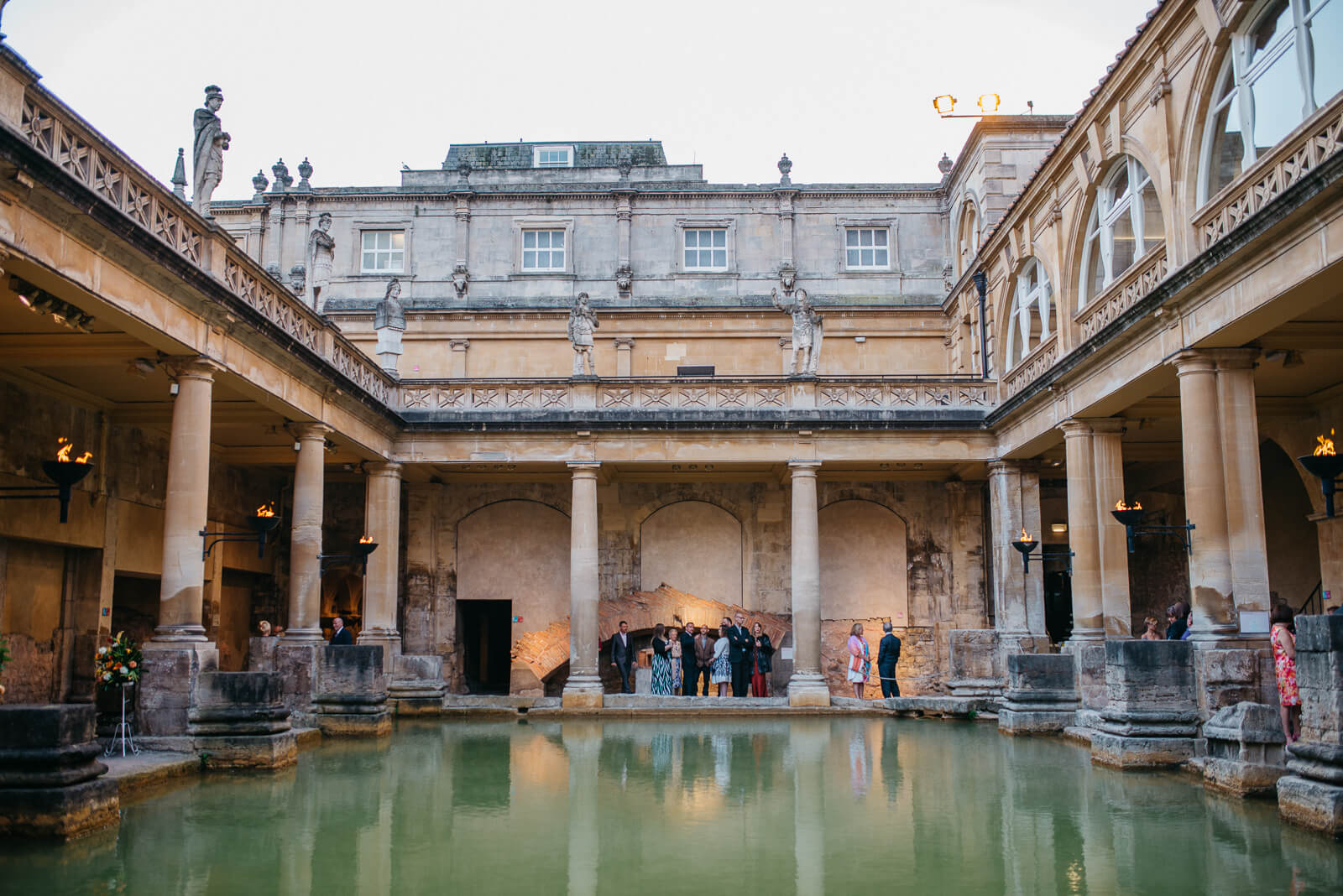 Photograph looking across the Roman Baths towards guests gathered awaiting Bride