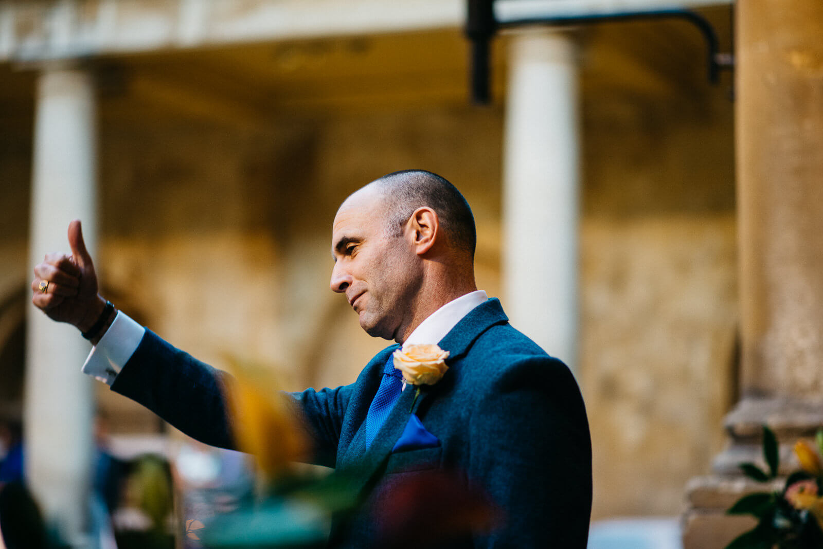 Best man thanking guests for their cooperation ahead of the Roman Baths ceremony