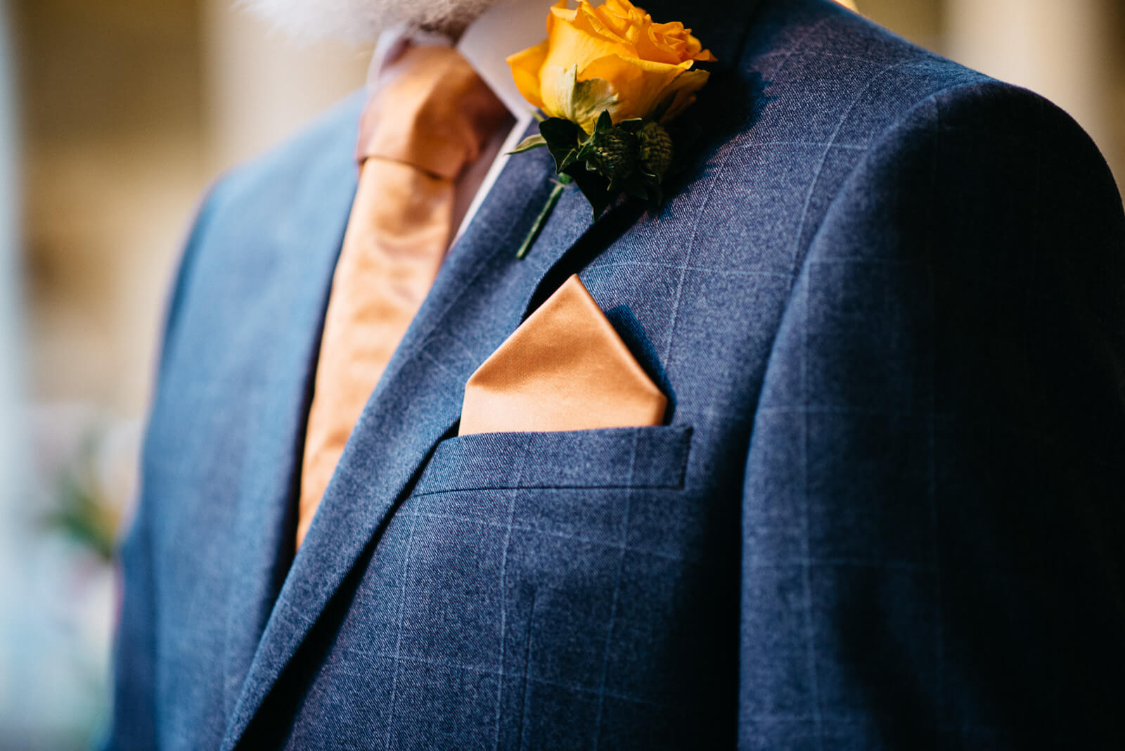 Stylish orange and navy groom details