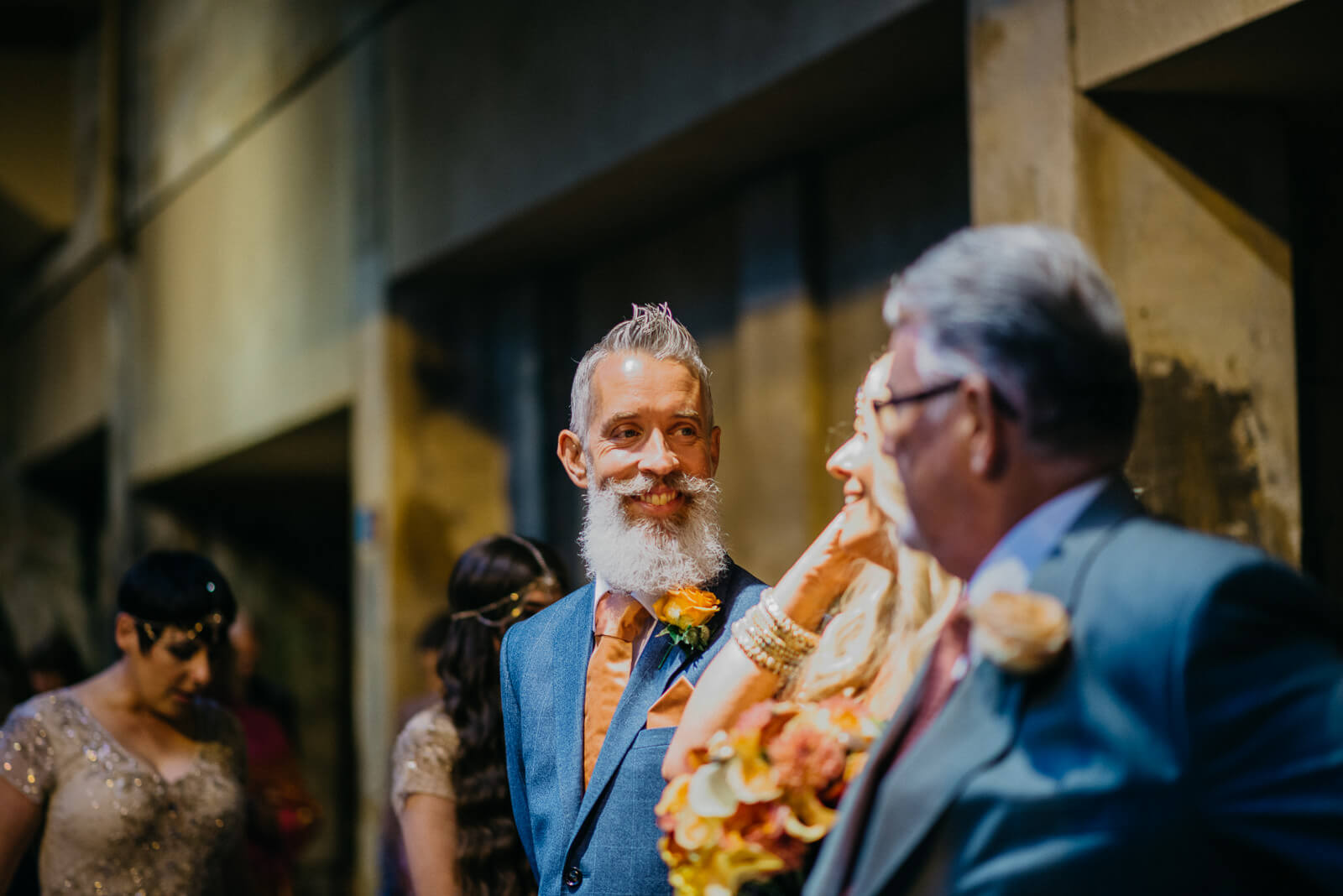 Groom smiling at bride just before their marriage ceremony at the Roman Baths