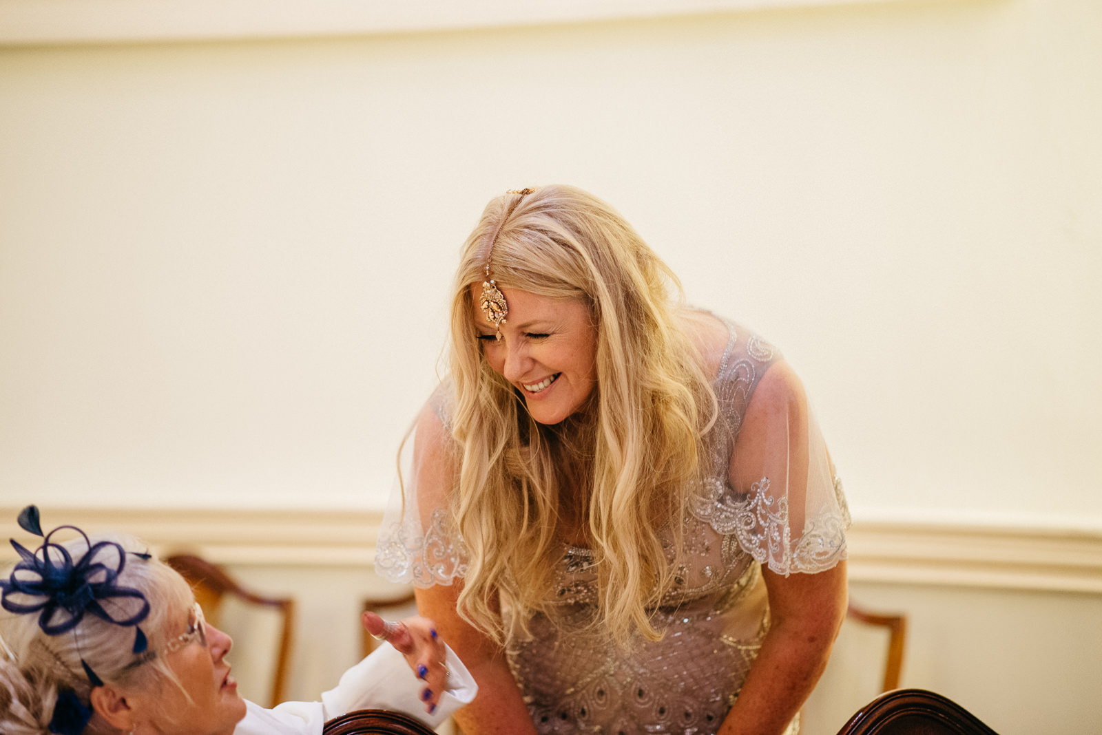 Bride laughing with guests at the Pump House wedding breakfaast