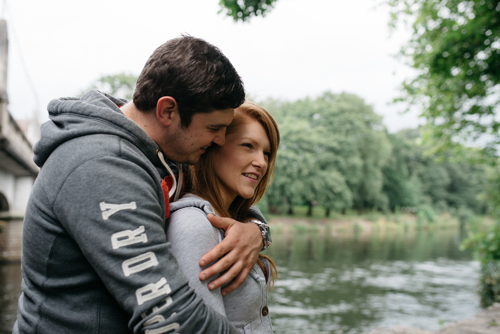 portrait of Jo and Lloyd next to the River Taff during their non-traditional engagement shoot