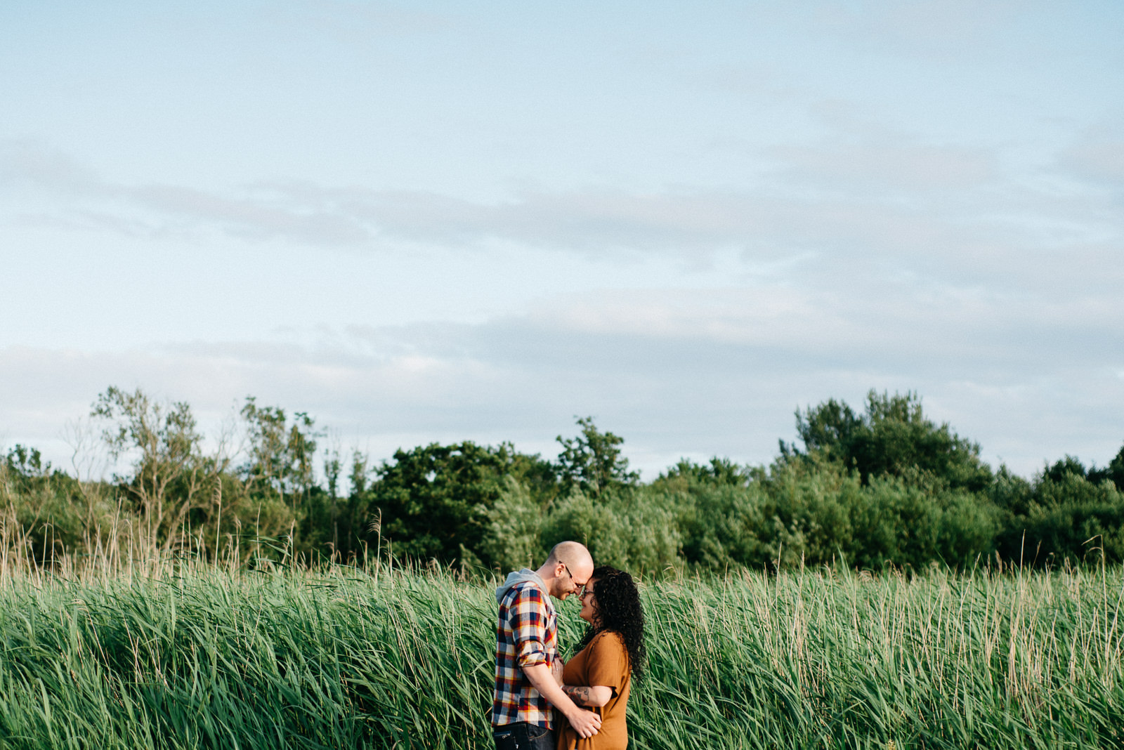 Summer Cosmeston Lake engagement session in reed bed