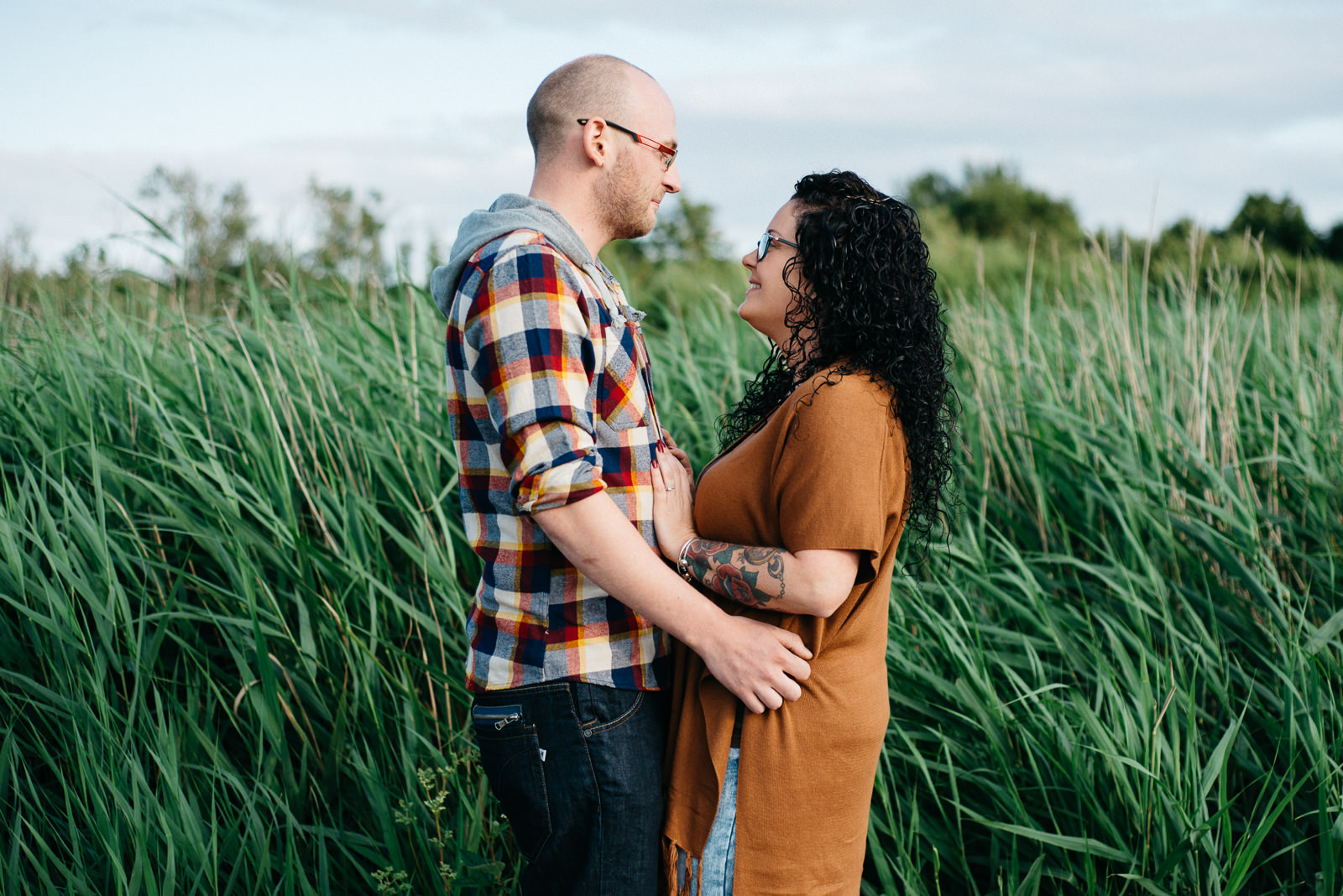 Earthy toned portrait of hipster couple during engagement shoot in Penarth Park
