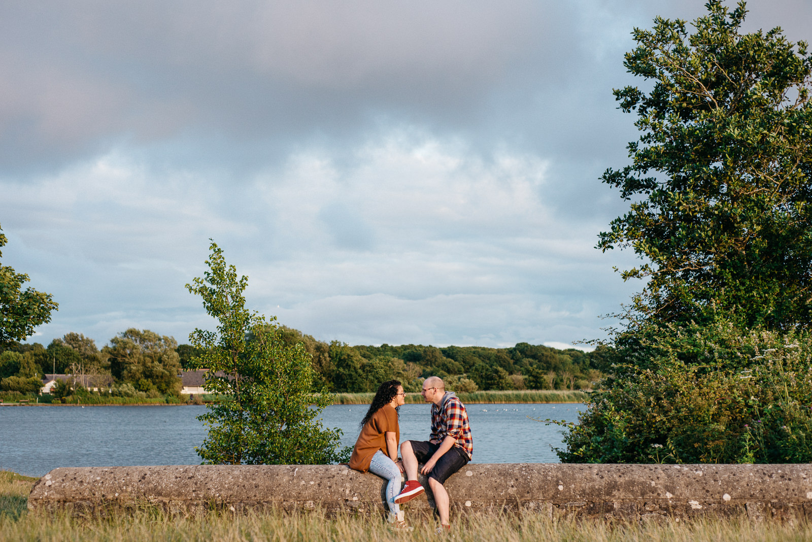 Sunset golden hour engagement shoot at the Lake in Penarth