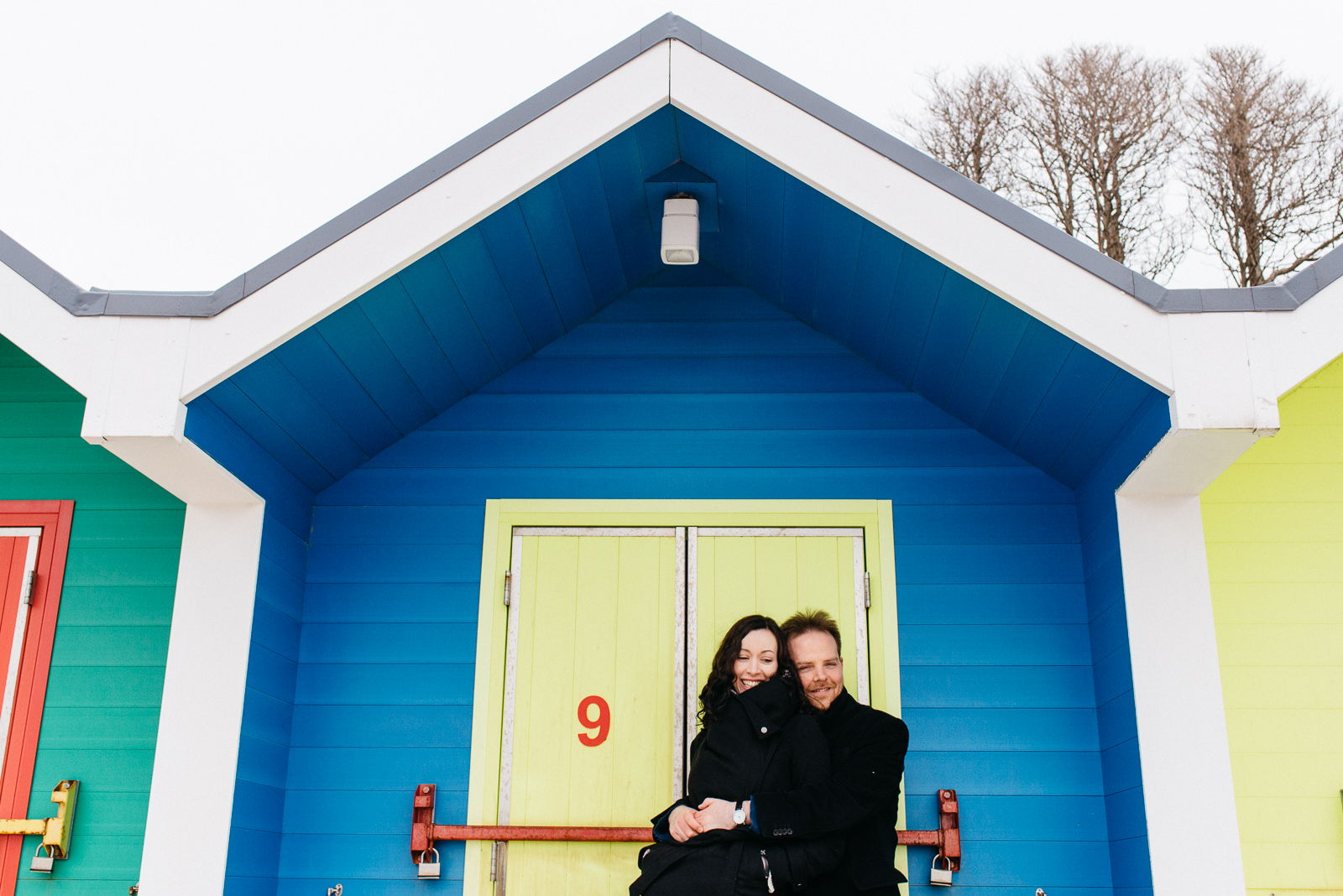 Alternative wedding photographer Cardiff. Welsh coast beach engagement with beach huts // Elaine Williams Photography
