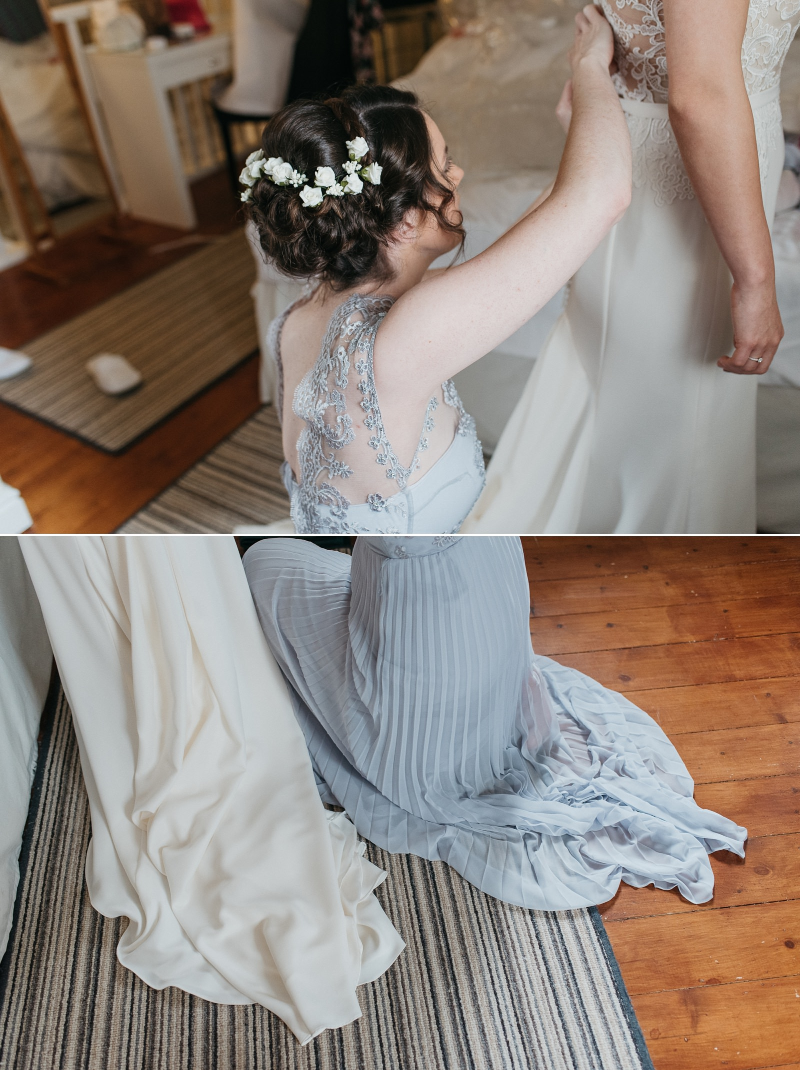 Bridesmaid helping bride into wedding dress