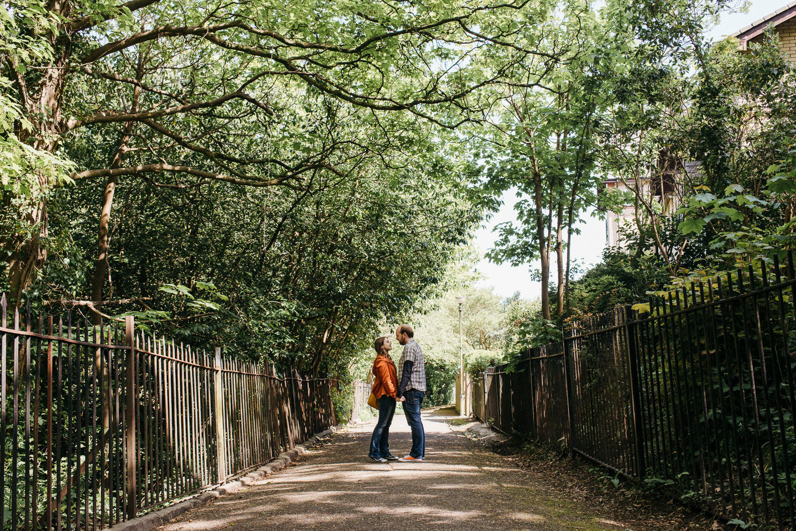 Couple under tree canopy at Penarth engagement session