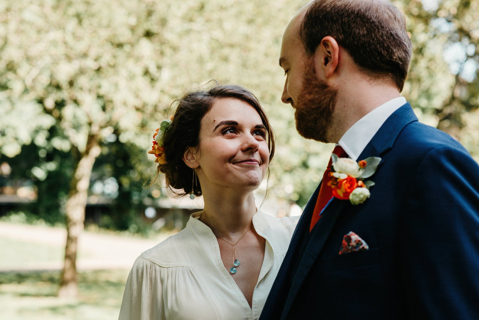 Bride looking loving at her groom following thier wedding at the Royal College of Music and Drama