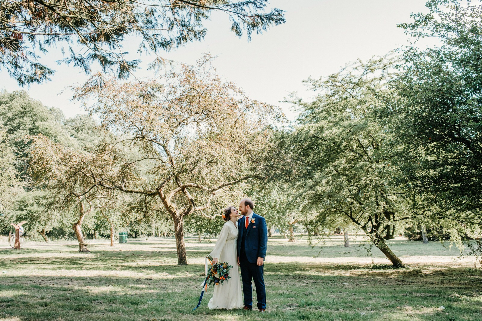 Natural photograph of Cardiff bride and groom in bute park