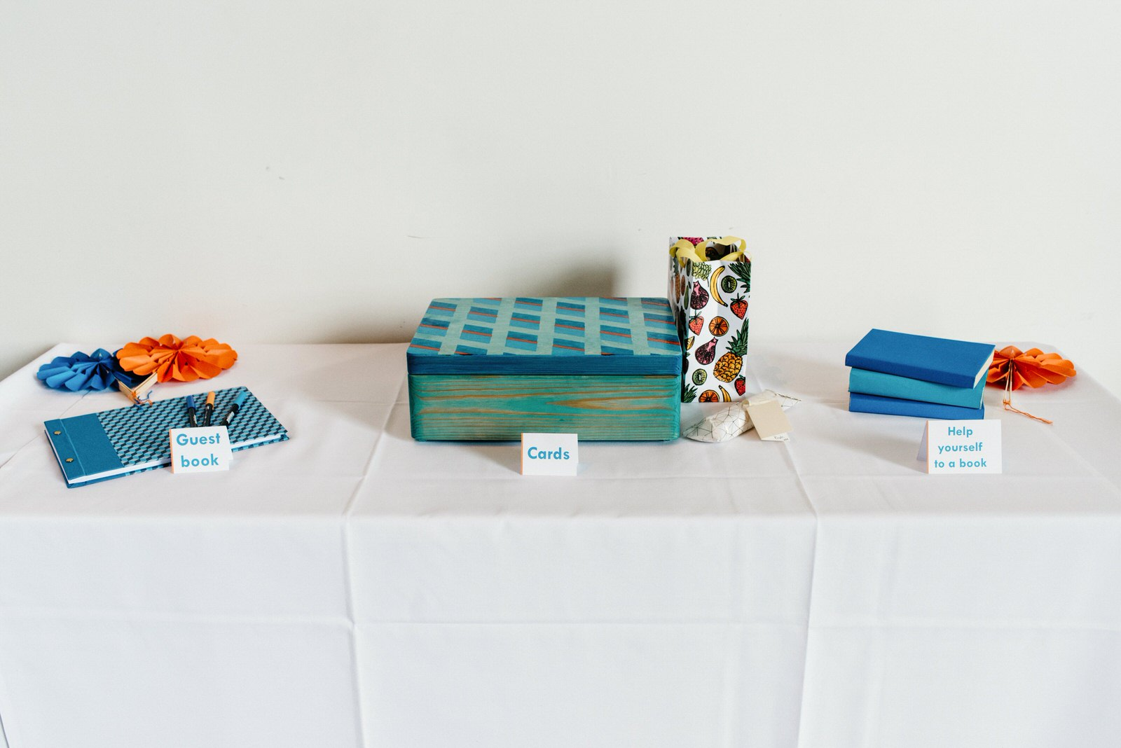 Quirky colourful decor details including guest book and place to put cards