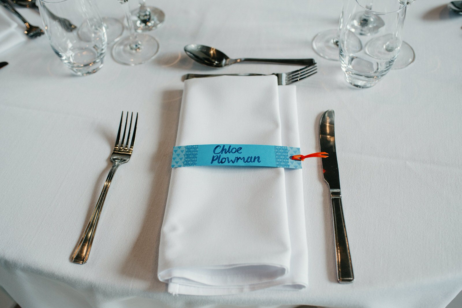 Quirky place setting details in blue and orange