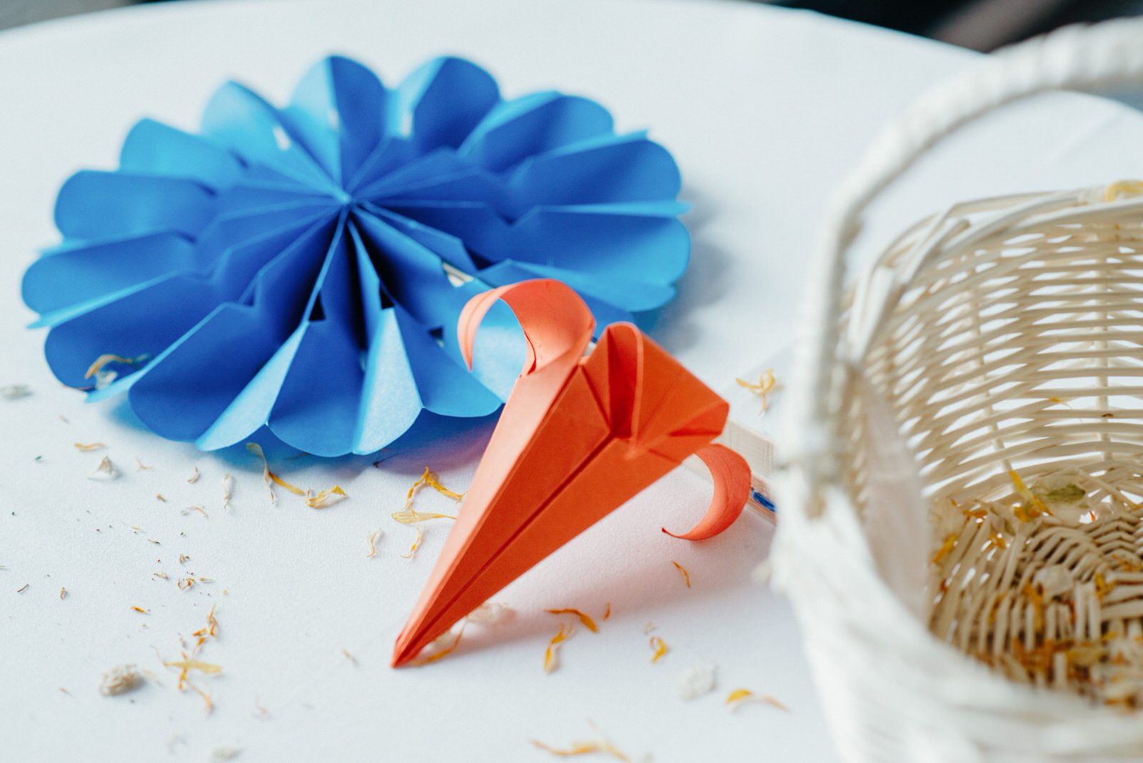 Blue and orange paper origami decor details at a Cardiff wedding
