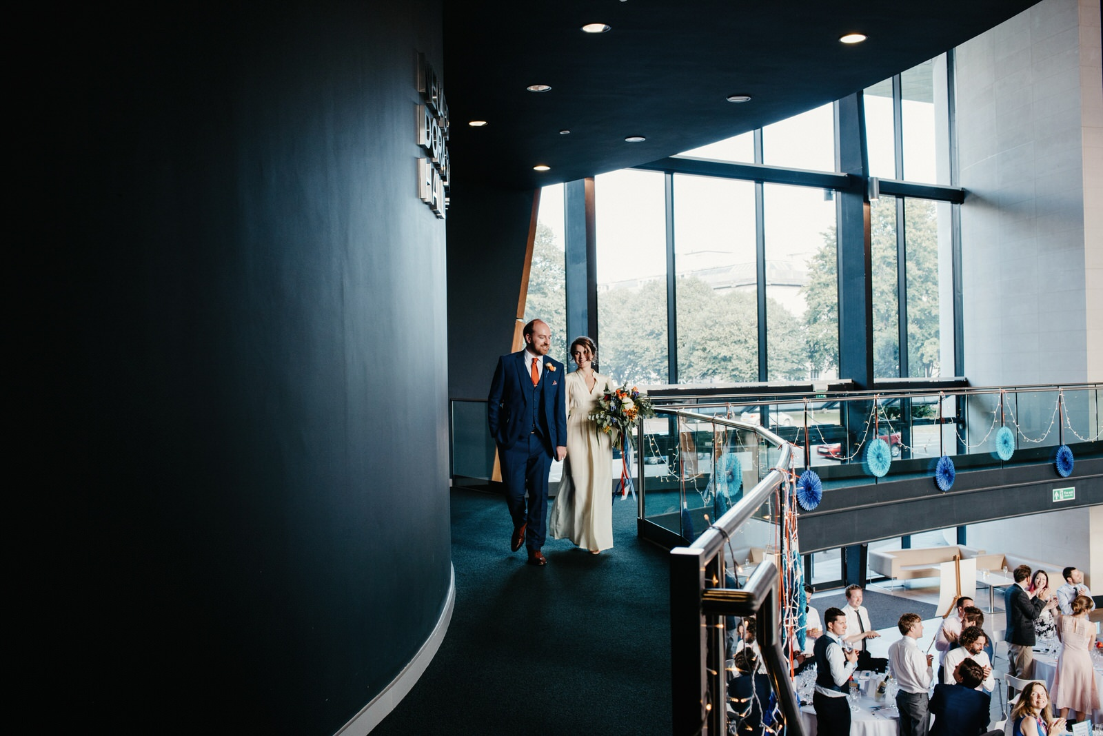Bride and groom making grand entrance at Cardiff wedding venue the Royal College of Music and Drama