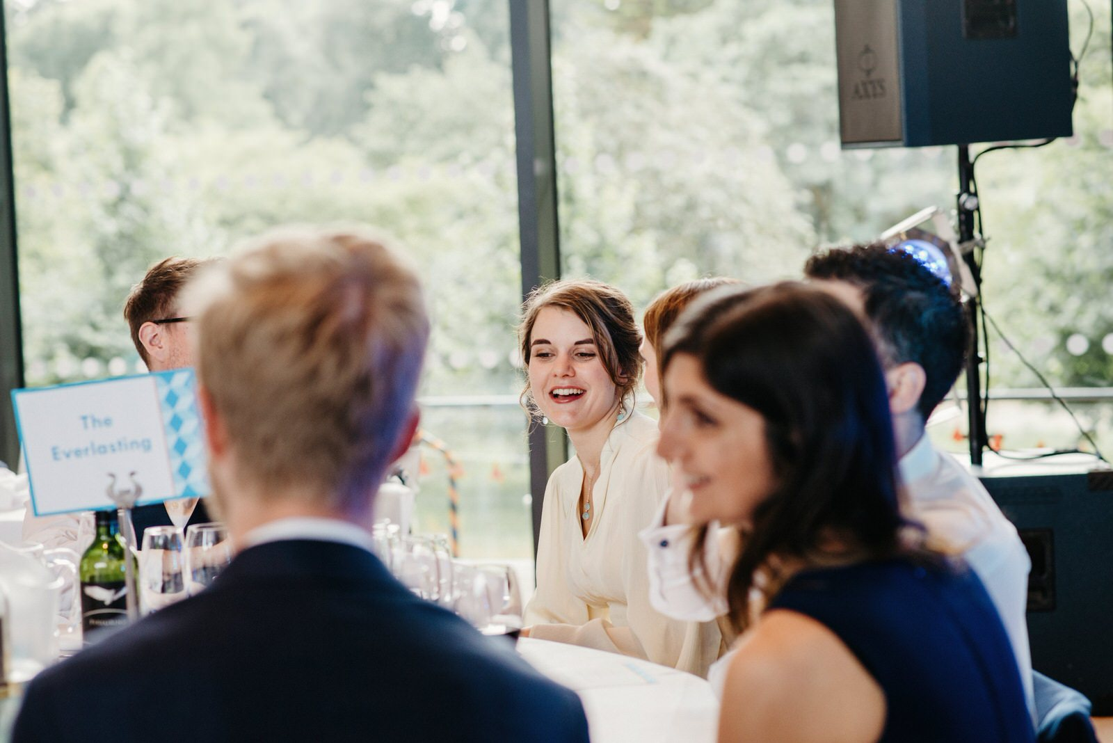 Bride mingling with guests during the wedding breakfast the Royal College of Music and Drama