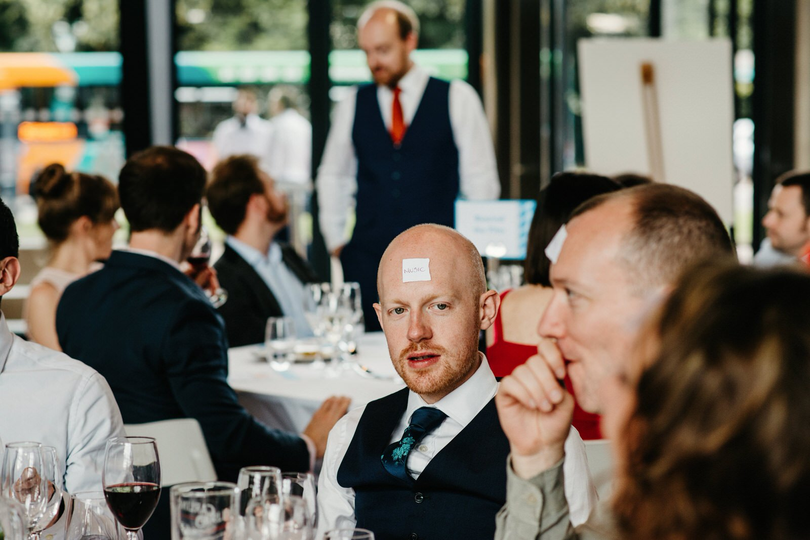 wedding guests playing games during speeches at the Royal College of Music and Drama