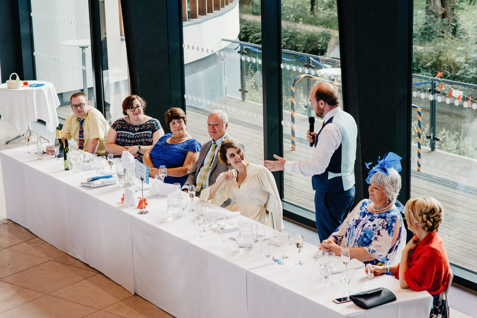 groom delivering his speech to the top table at the Royal College of Music and Drama
