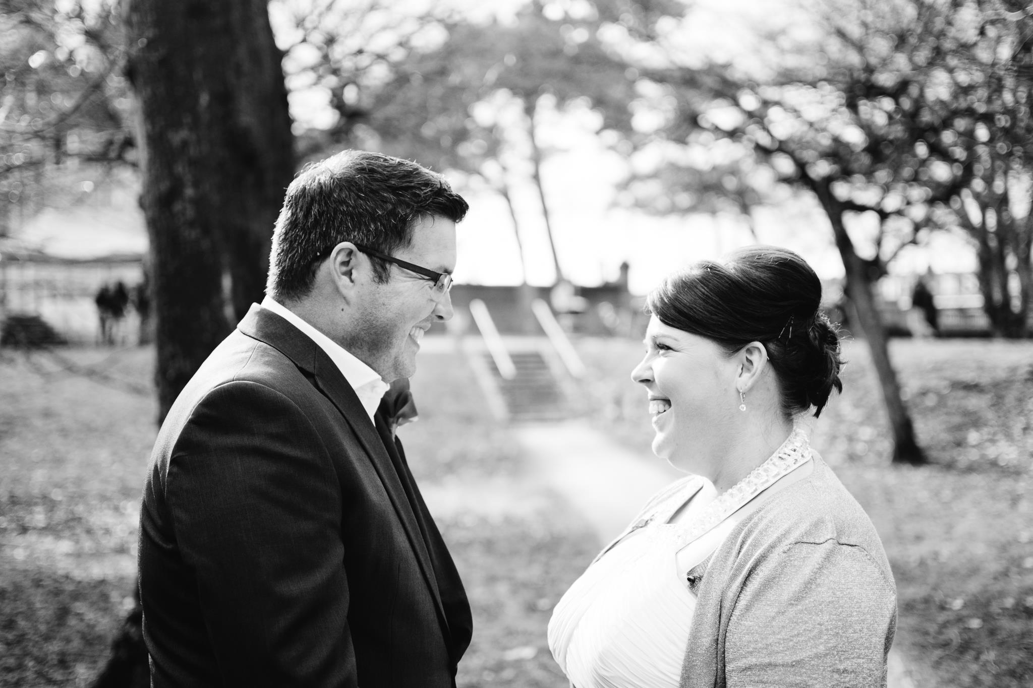 Black and white photography of bride and groom glowing following their intimate Cardiff ceremony