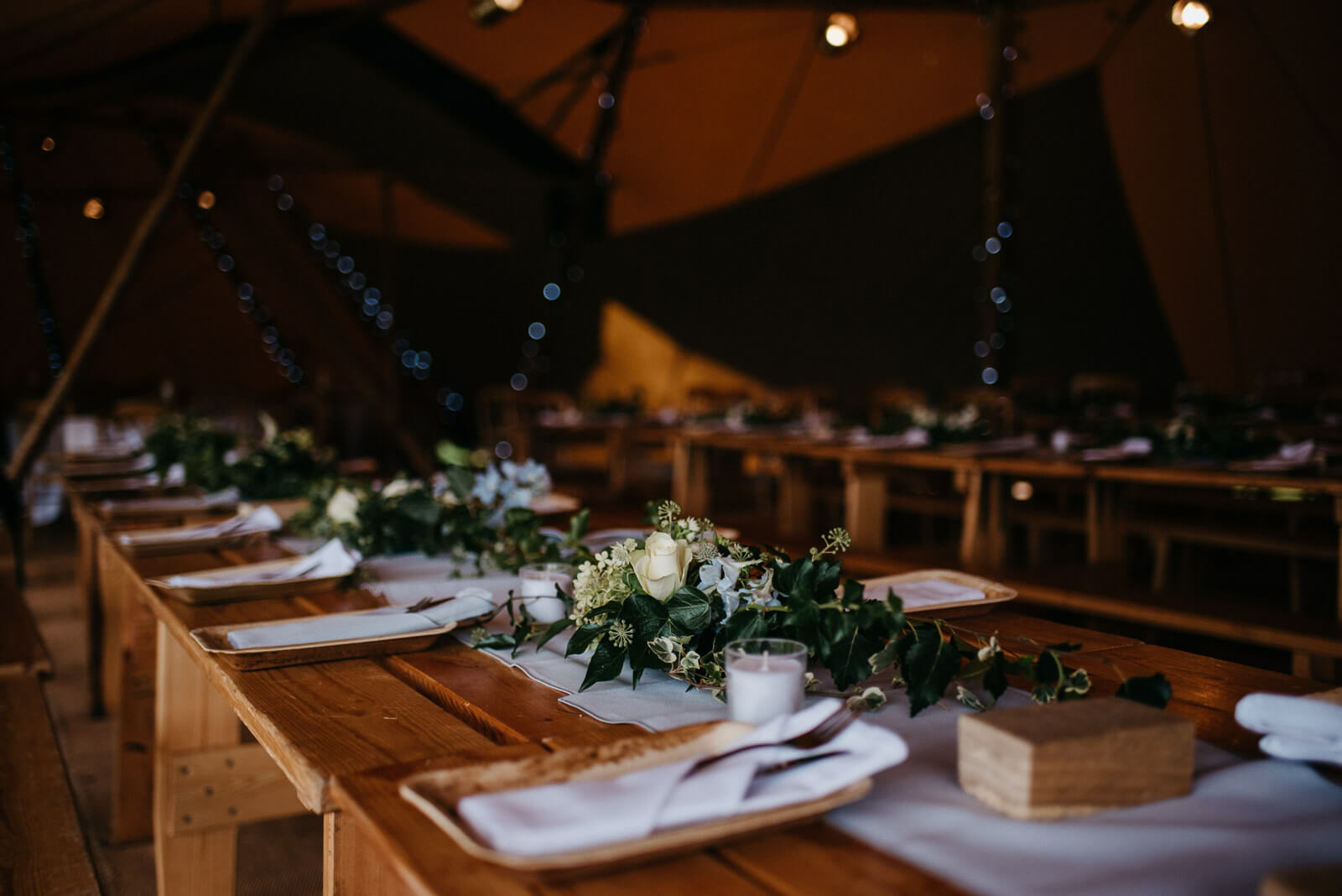 Beautiful tipi table arrangements for a Shropshire festival wedding