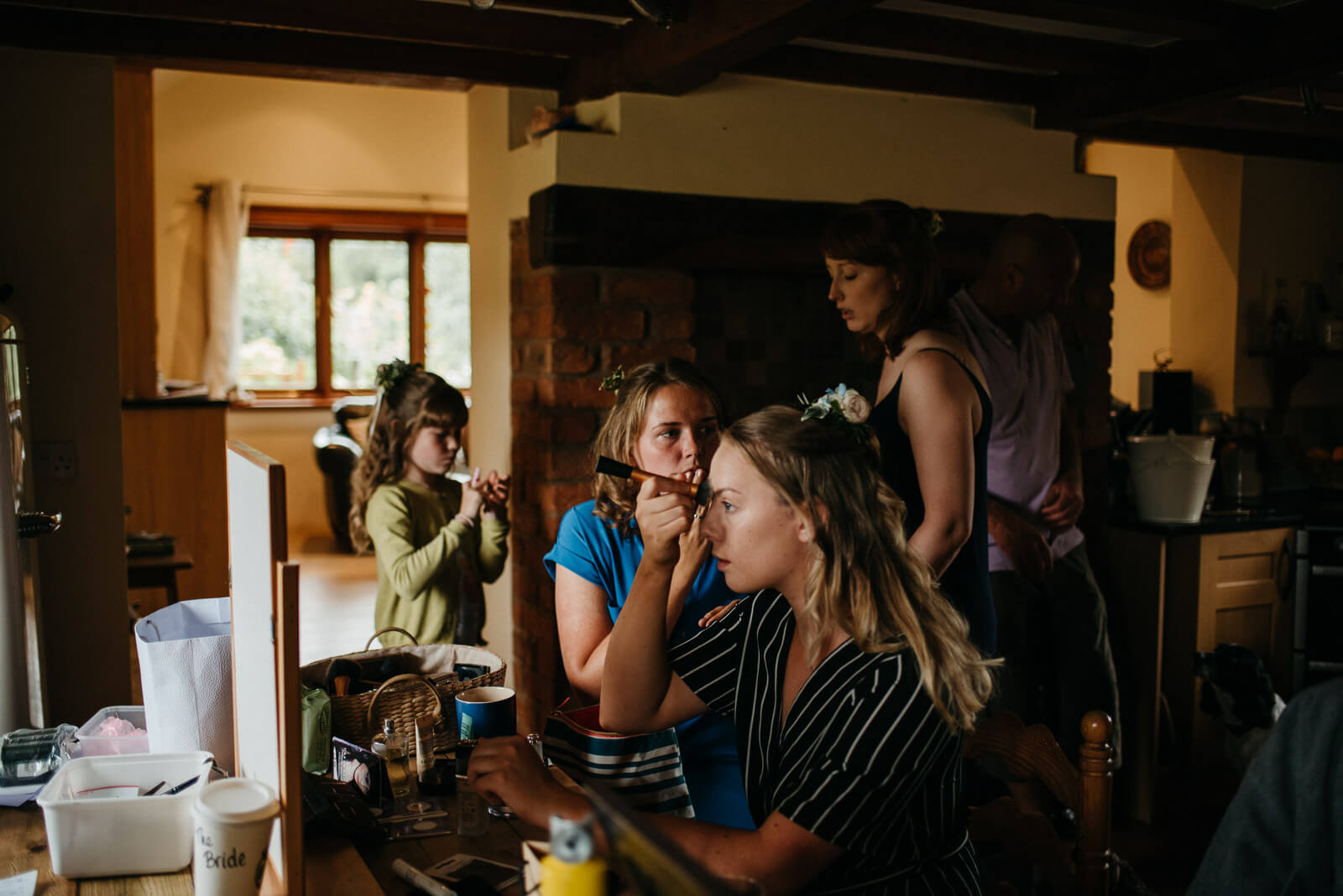 Bridesmaids getting ready at the brides family farmhouse in Shropshire