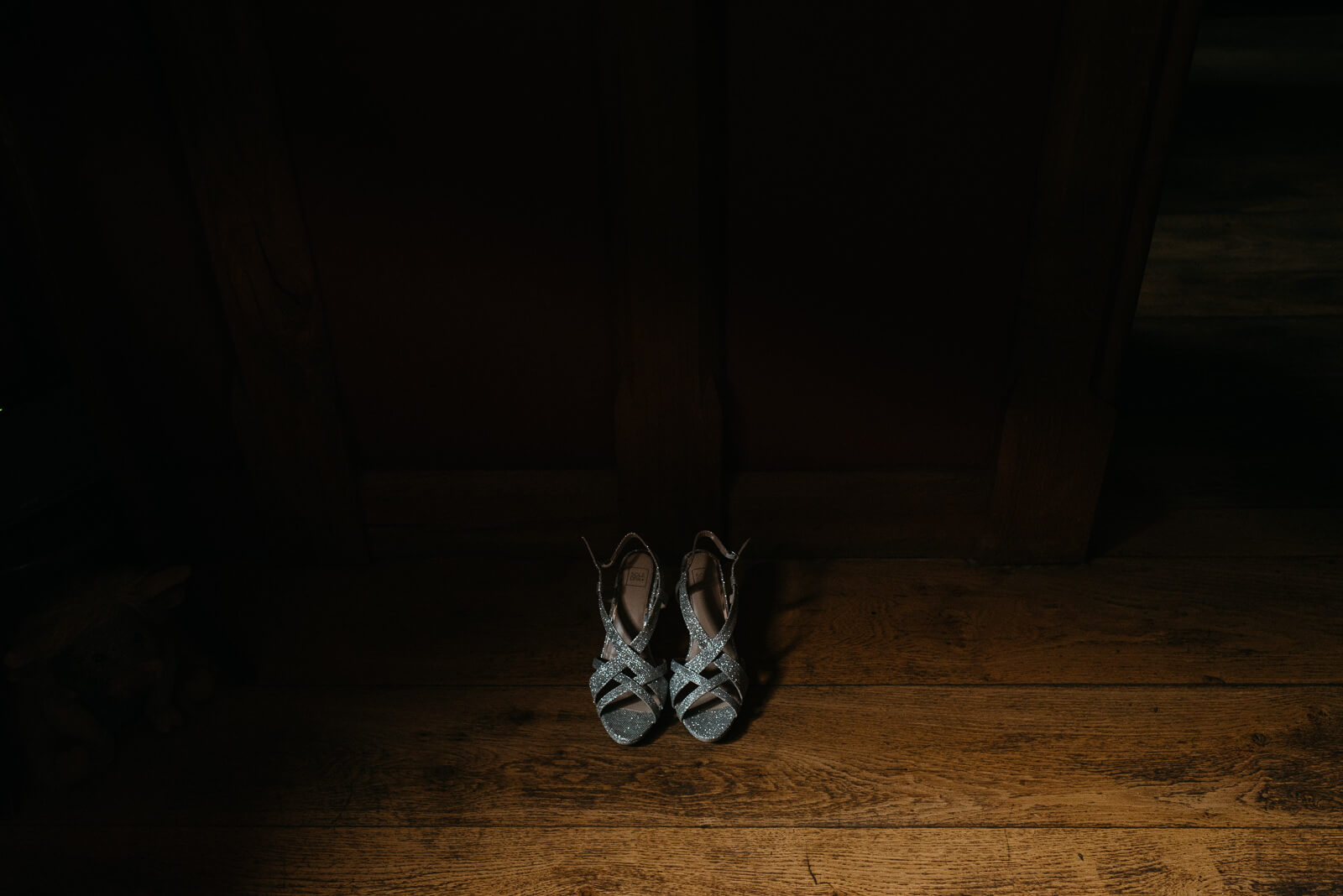 Moody detail photograph of the brides Jimmy Choo style shoes for her Shropshire festival wedding
