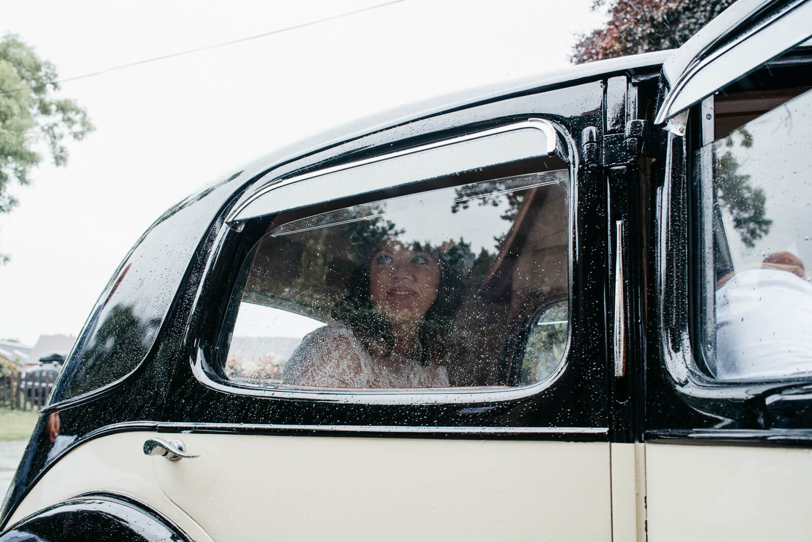 Bride arriving at church in vintage car