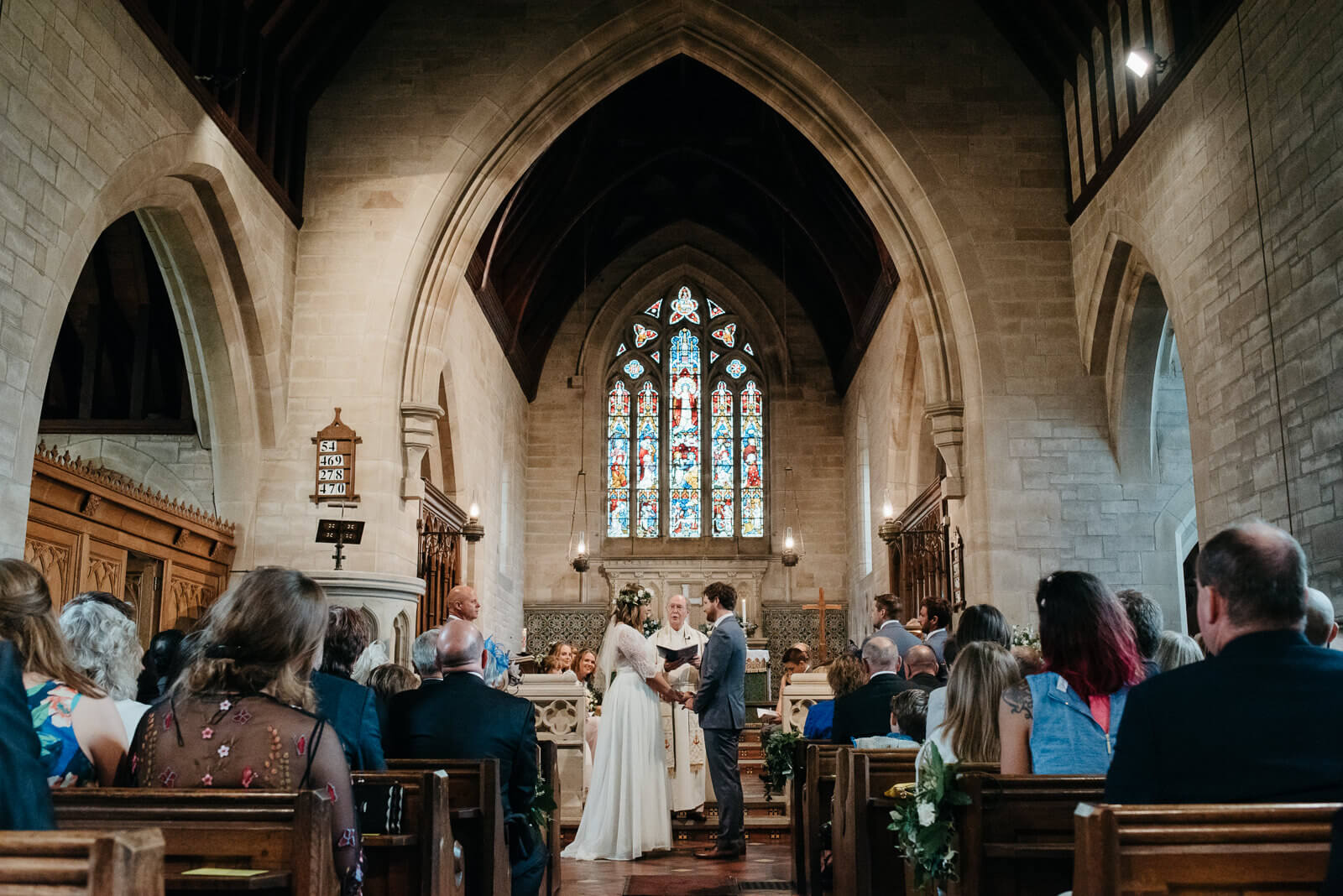 Bride and groom exchanging vows at Bettisfield Church in Shropshire