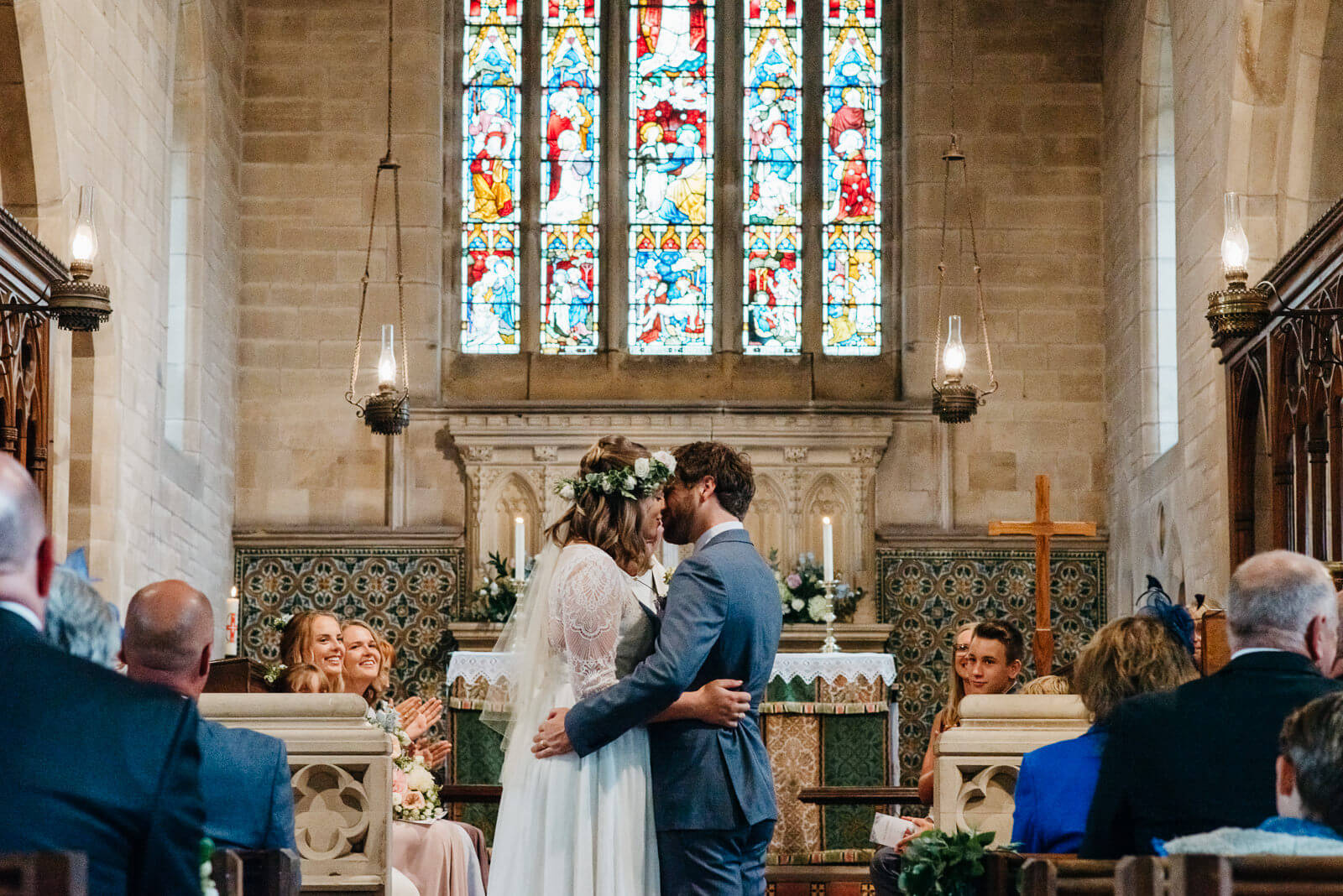 Bride and groom kissing during wedding ceremony at Bettisfield Church, Shropshire