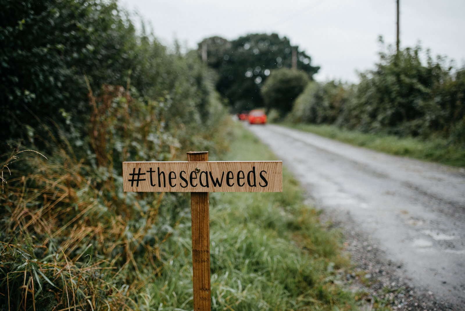 Wooden signage displaying couples hashtag at shropshire wedding