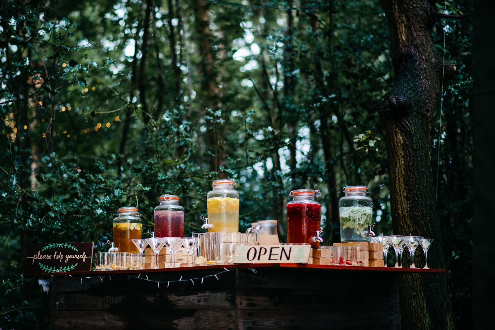 Woodland bar stocked with punch cocktails for tipi wedding in Shropshire
