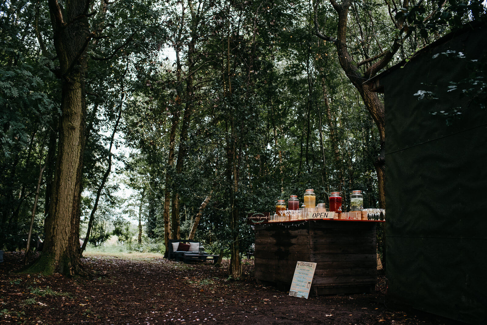 Woodland bar and fairy light observatory on the edge of Shropshire nature reserve at tipi festival