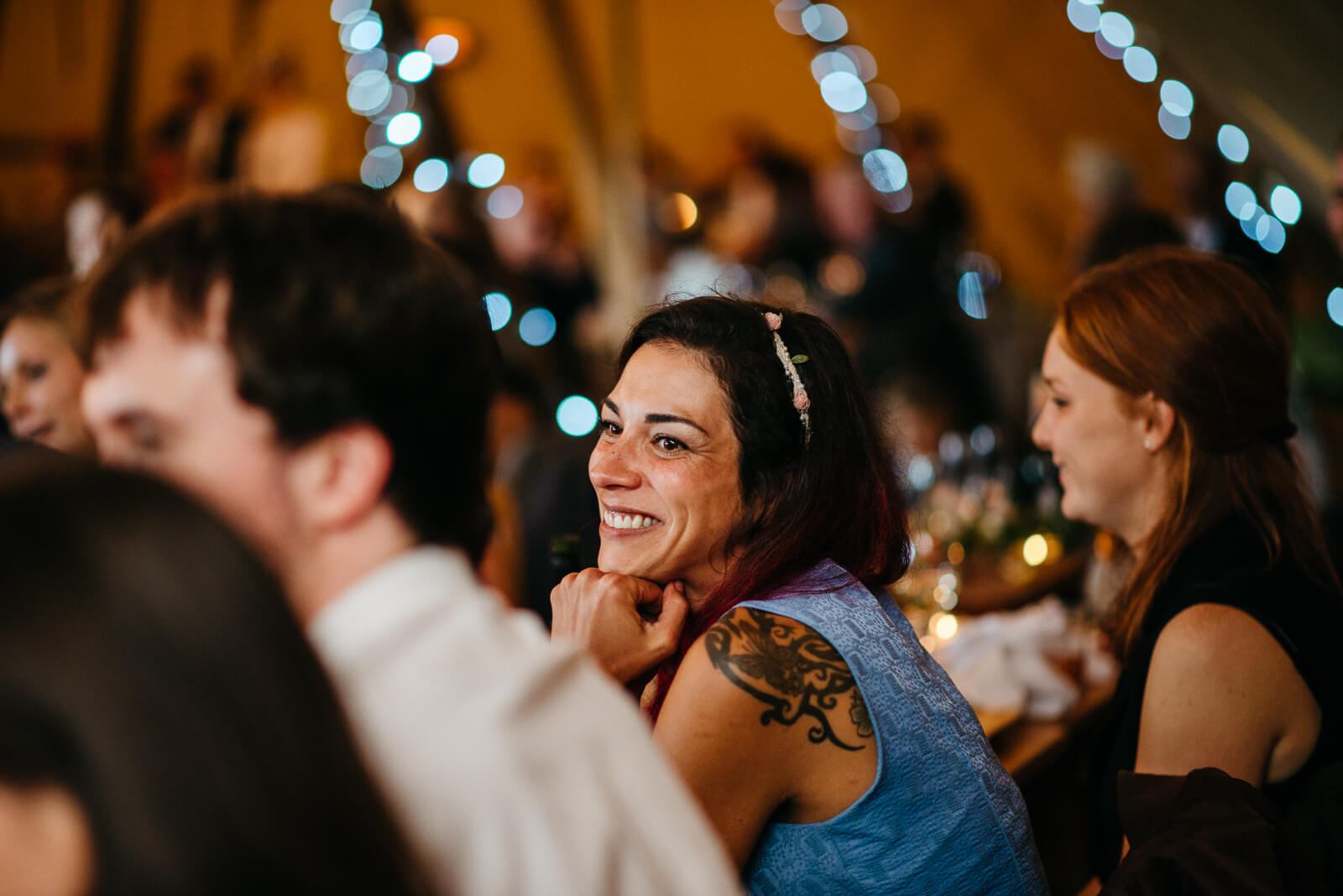 Guests smiling during speeches at Shropshire tipi wedding