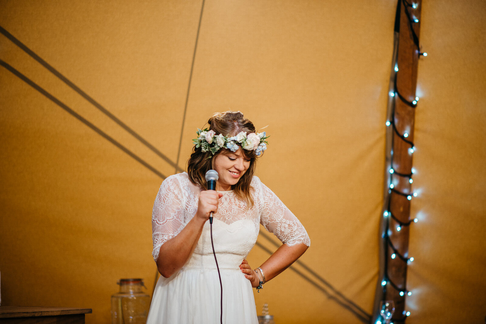Bride in tipi giggling during her speech