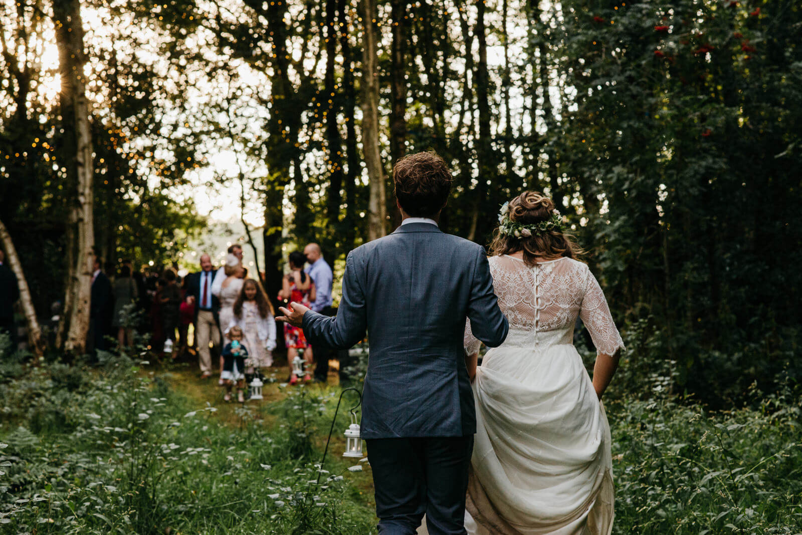 Bride and groom return to their woodland reception following relaxed portraits in Shropshire mosses