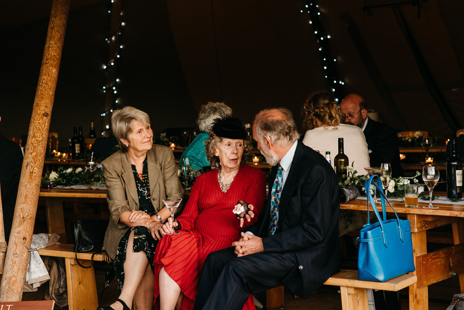 Guests chatting at tipi wedding in Shropshire