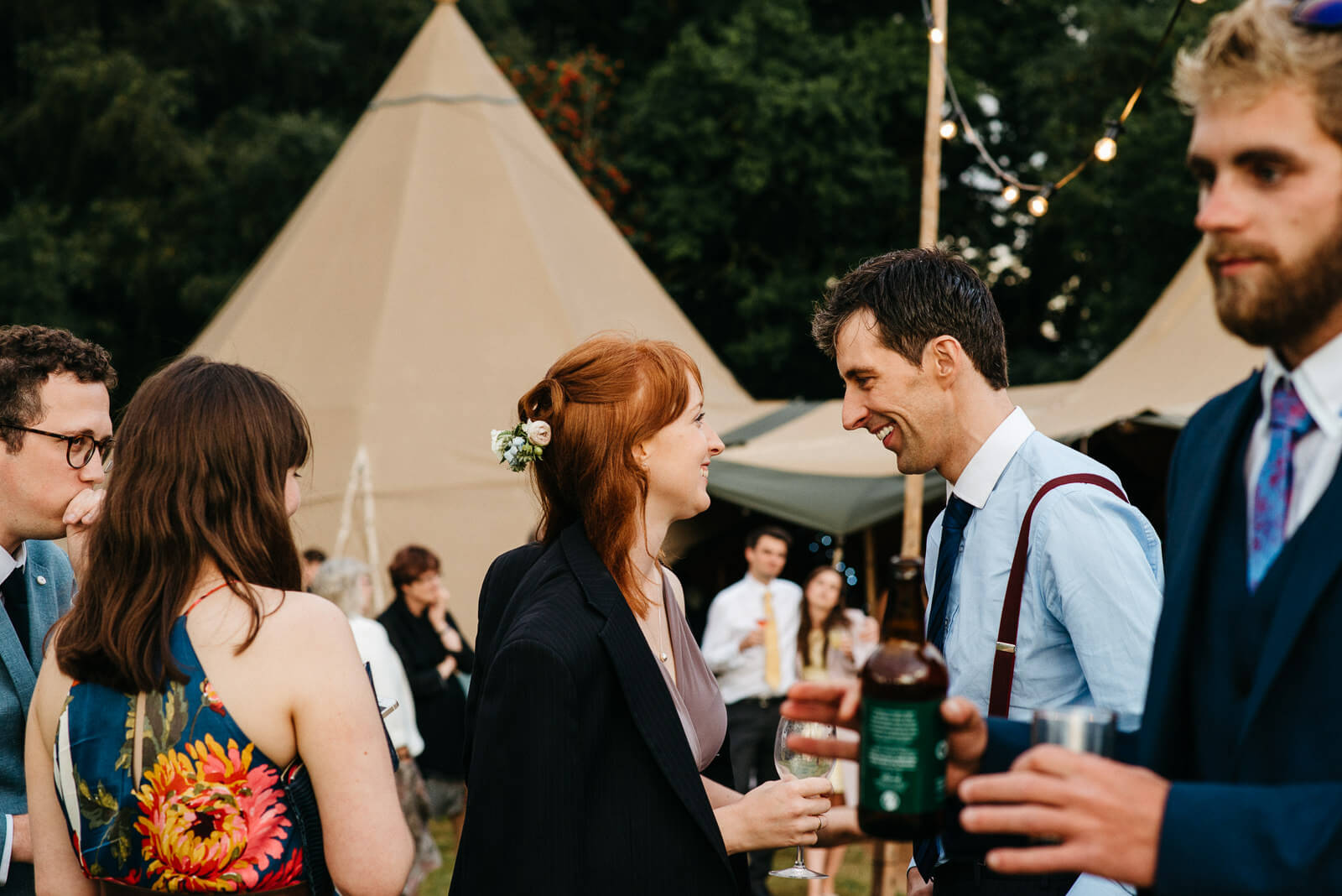 Guests laughing at Shropshire festival wedding
