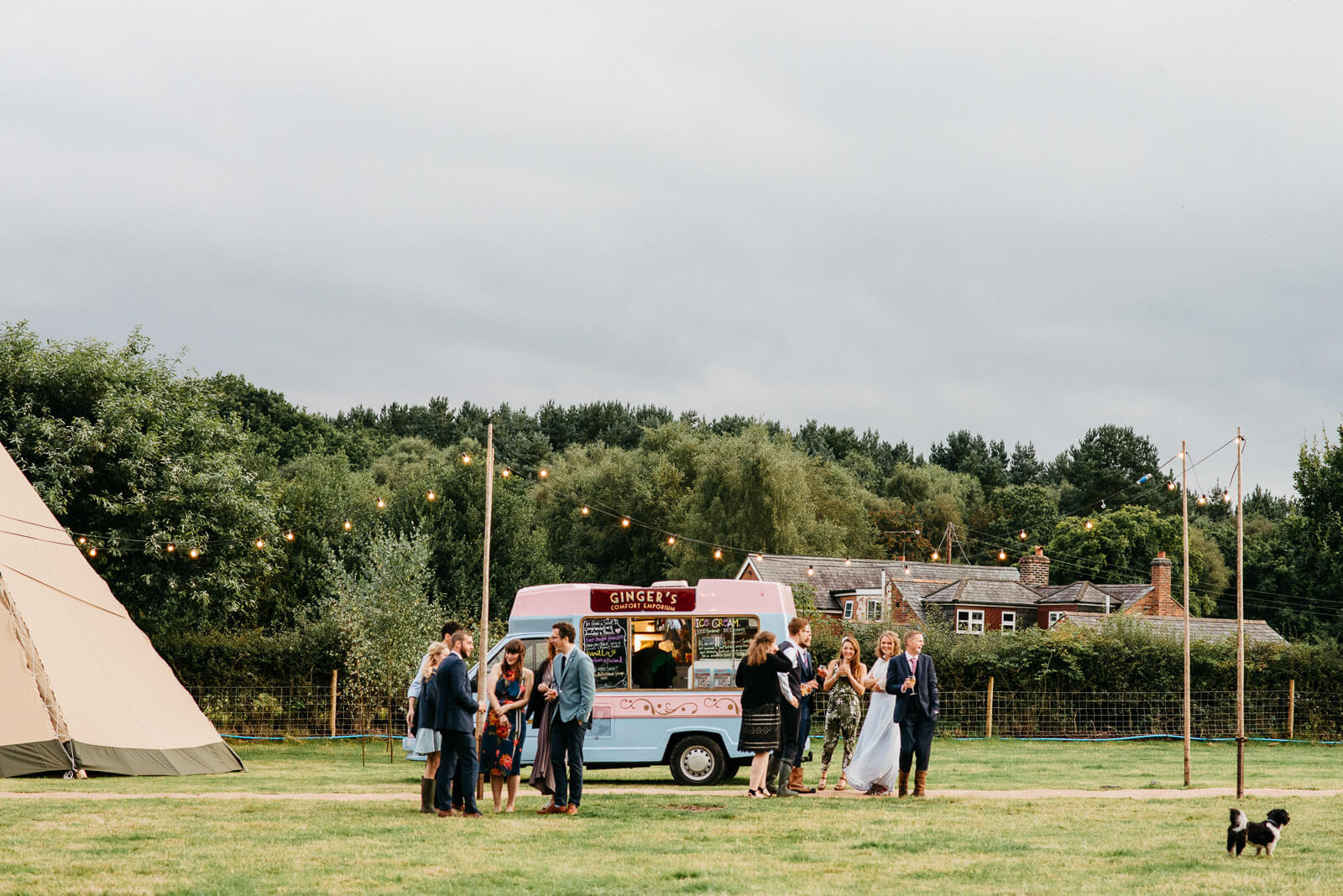 Guests congregate next ice cream van at relaxed nautral Shropshire wedding