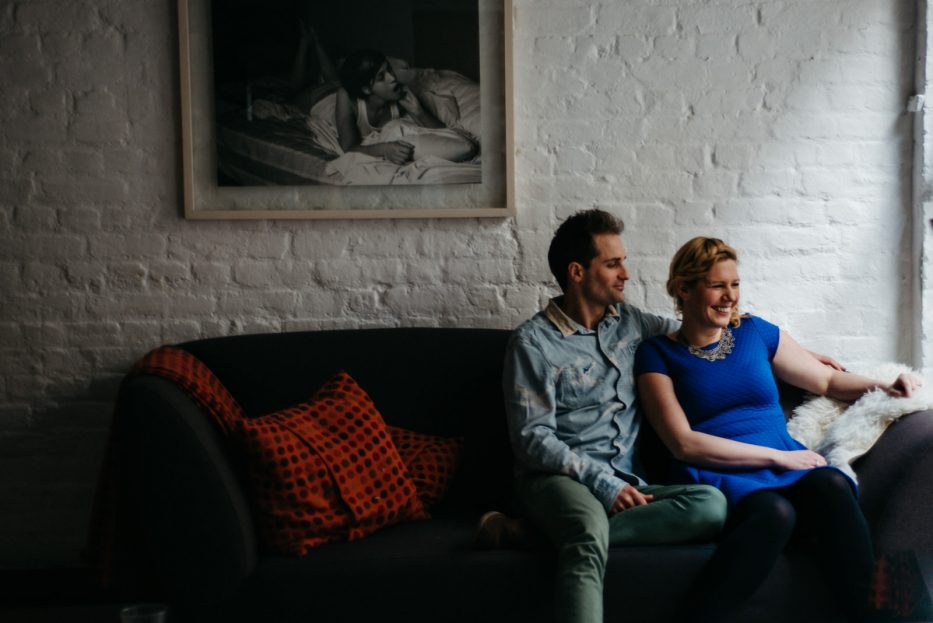 Couple relaxing at home during their Shoreditch couple shoot in East London