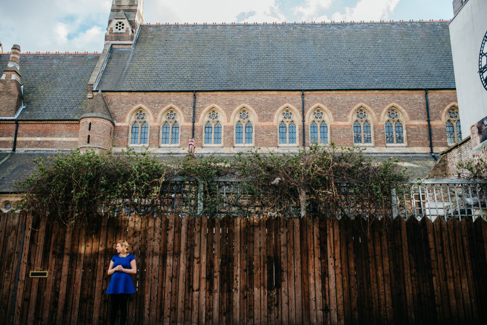 Bride standing in front of old Church in Shoreditch, East London