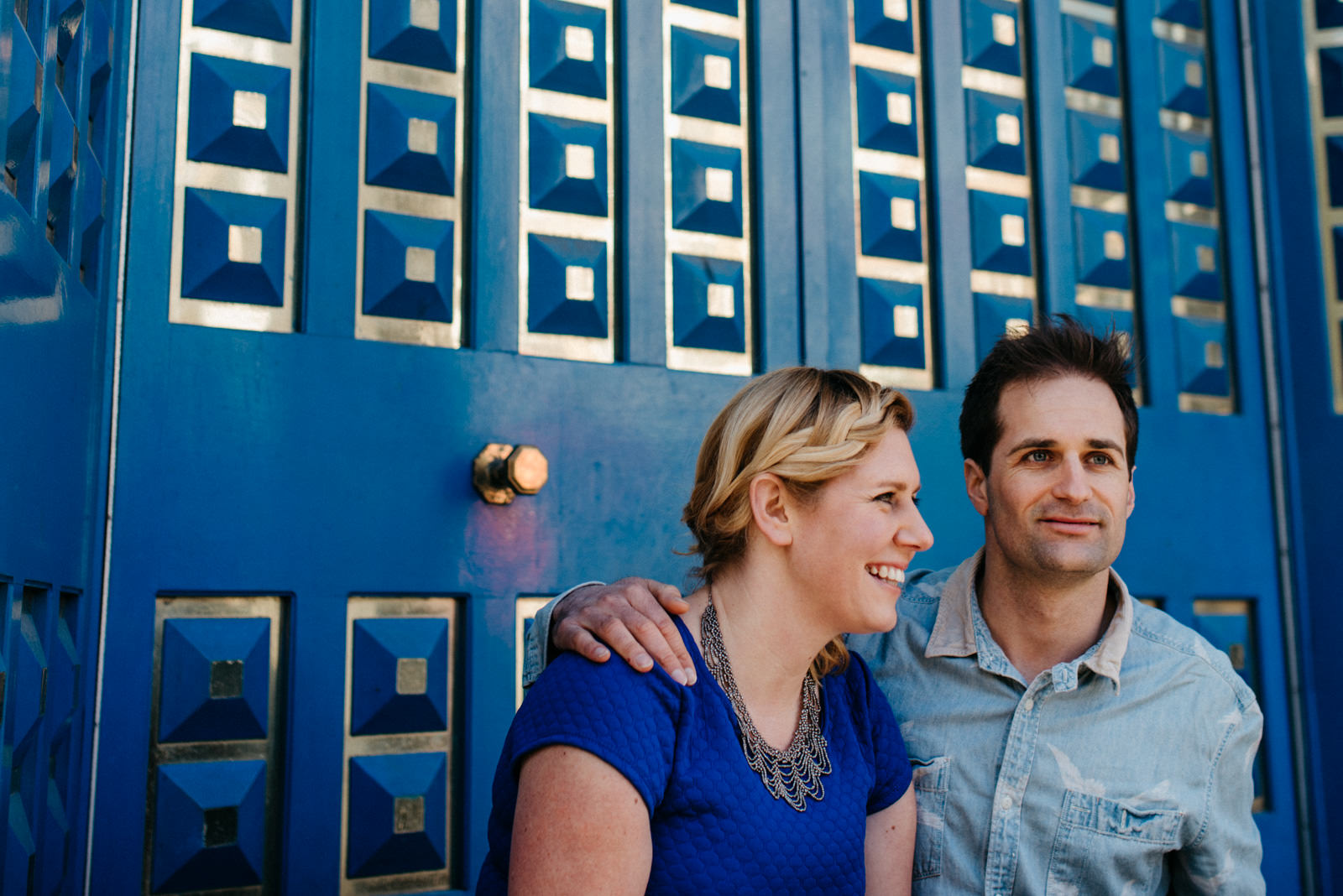 Couple laughing on steps of a derilict building in Shoreditch