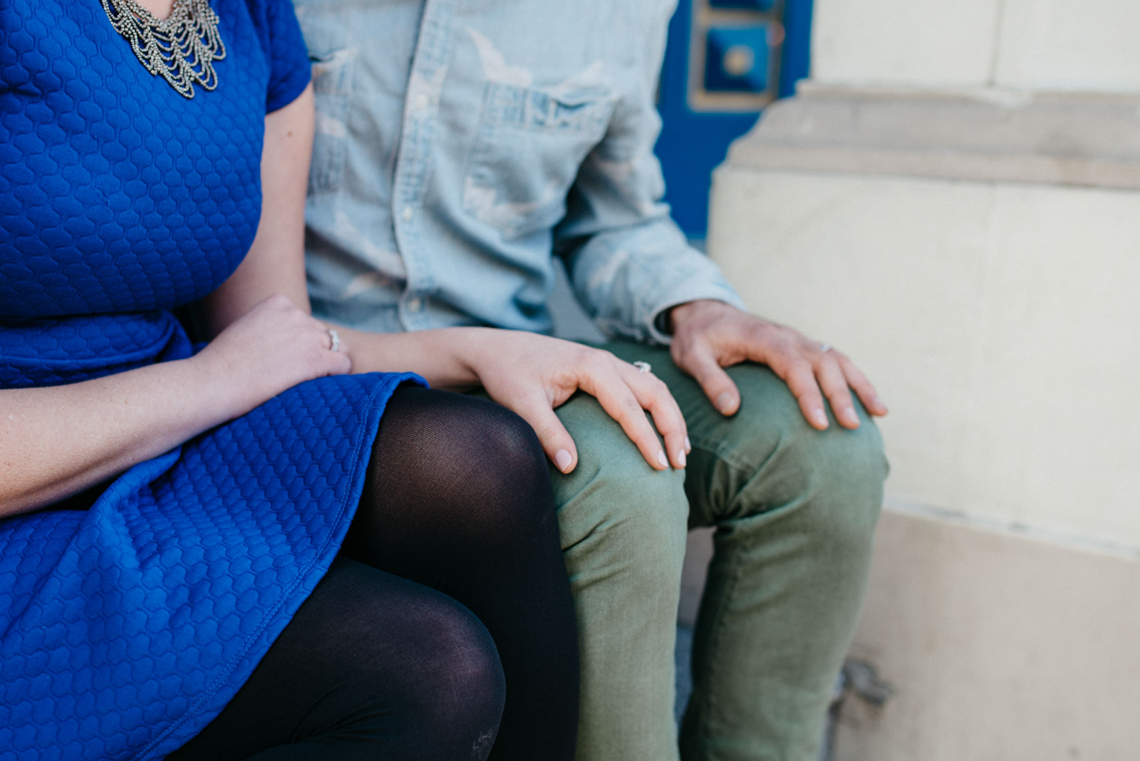 Bride lovingly places hand of grooms knee in Shoreditch