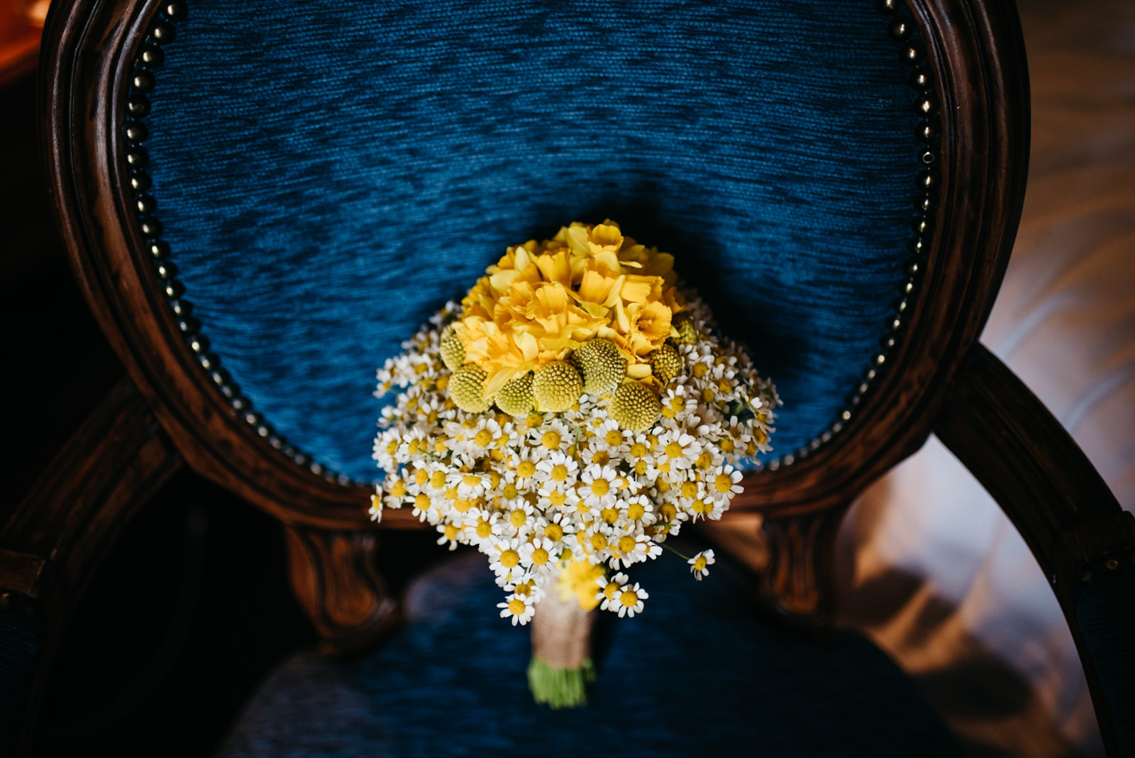 bouquet of daffodils and daisies on blue chair in New House Hotel, Cardiff