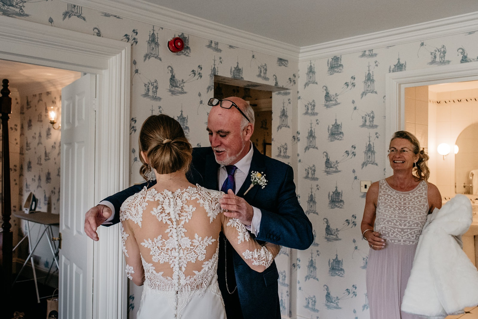bride hugging dad before leaving New House Hotel for Caerphilly Castle