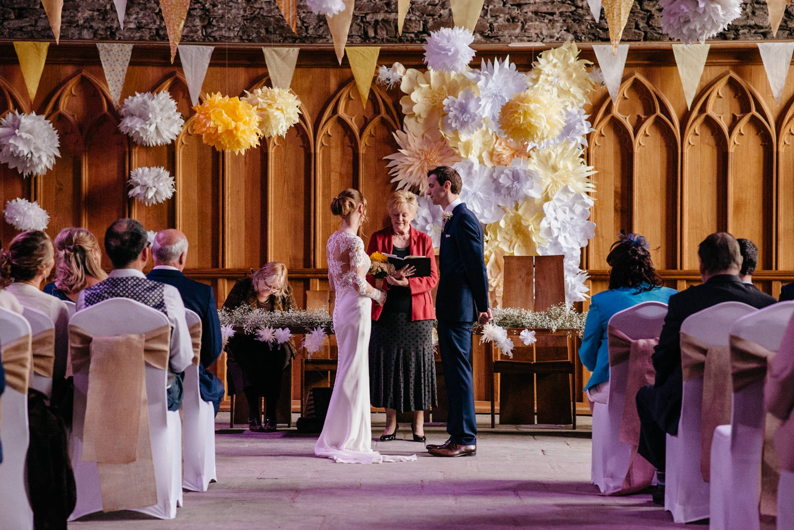 Couple exchanging vows at Caerphilly Castle Wedding